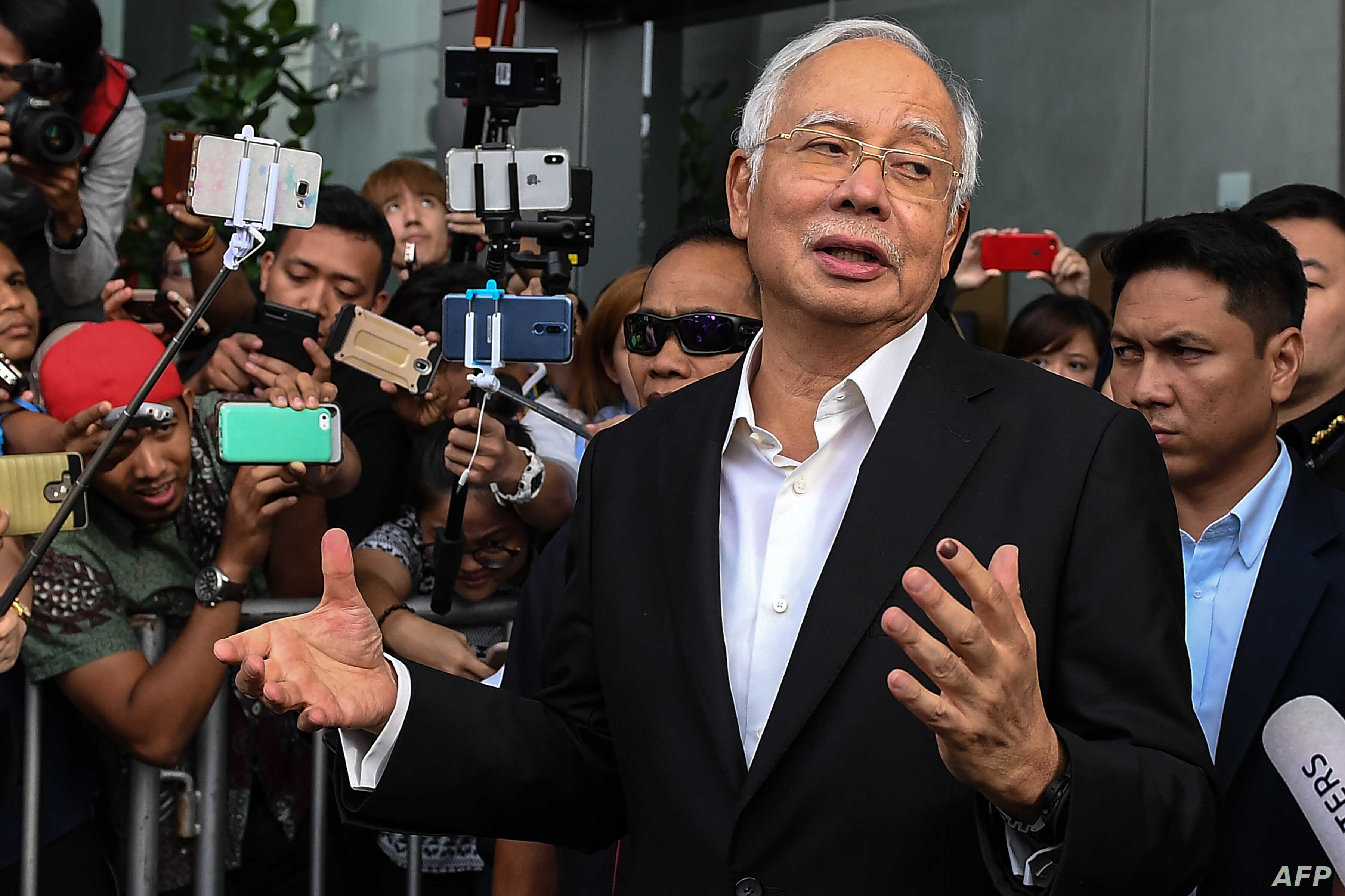 FILE - Malaysia's former Prime Minister Najib Razak speaks to the media after being questioned at the Malaysian Anti-Corruption Commission (MACC) office in Putrajaya, May 24, 2018.