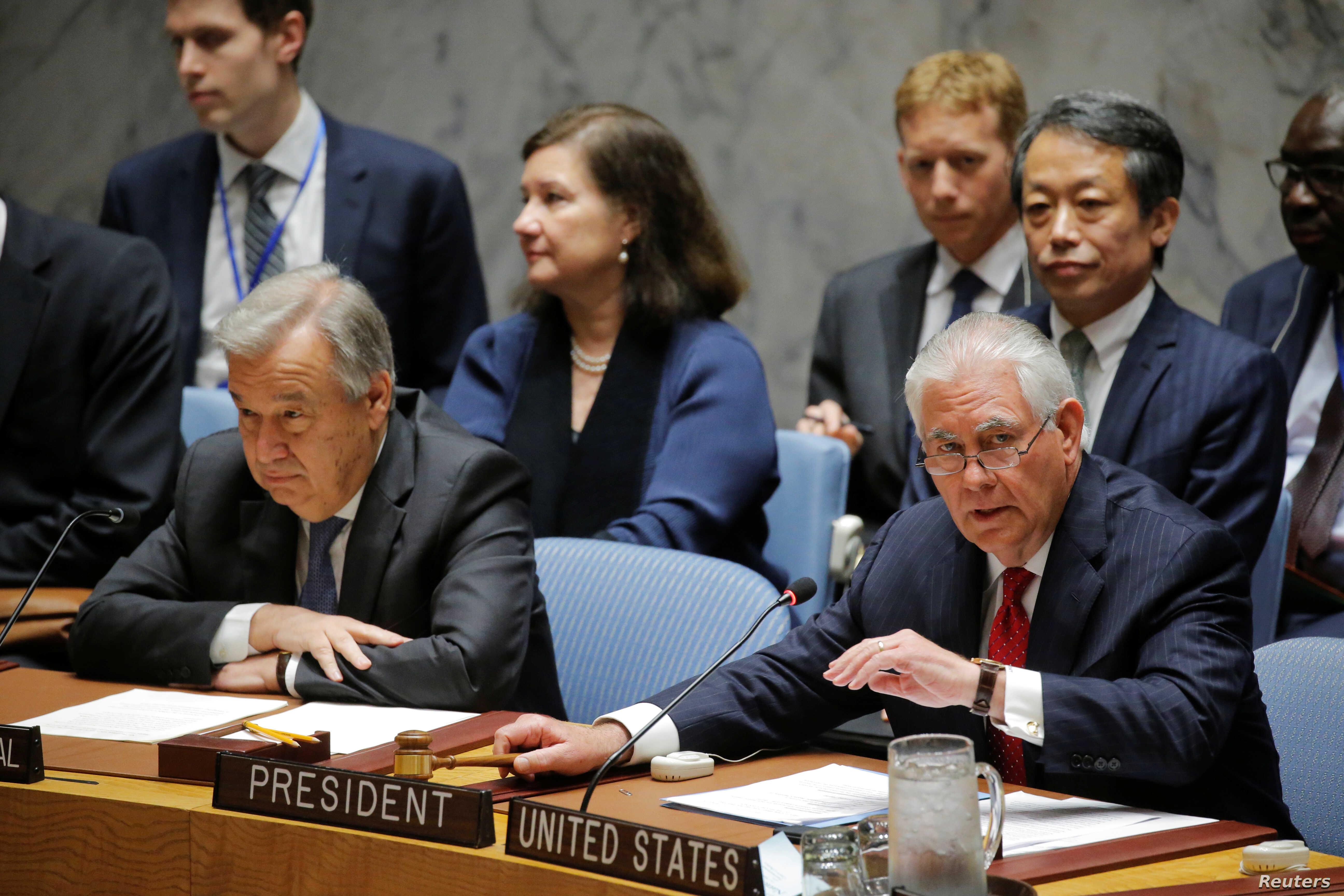U.S. Secretary of State Rex Tillerson (R) speaks next to U.N. Secretary-General Antonio Guterres during a Security Council meeting on the situation in North Korea at the United Nations (U.N.) in New York, April 28, 2017.