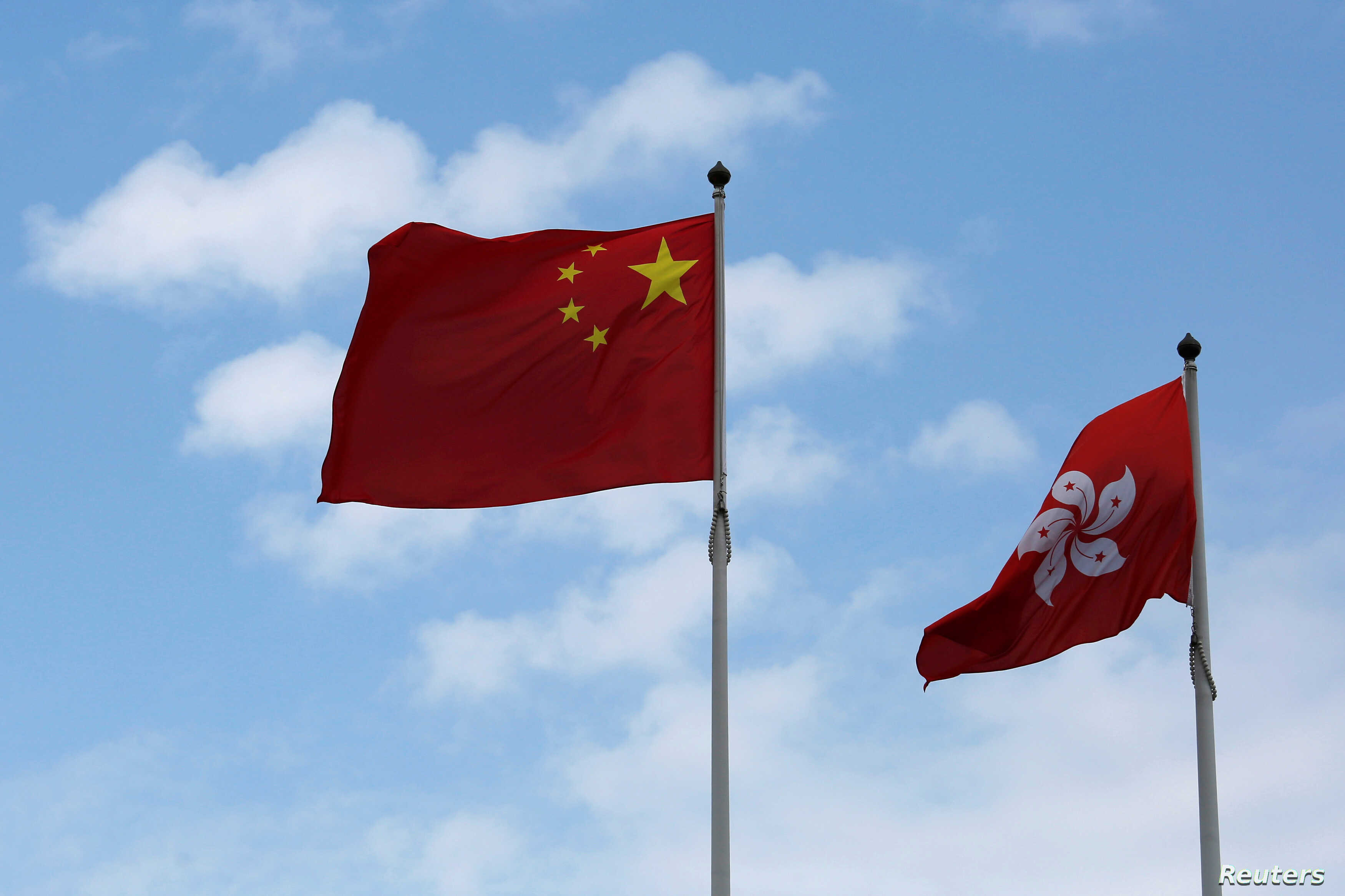 A Chinese national flag and a Hong Kong flag fly outside the Legislative Council in Hong Kong, China November 7, 2016, as China's parliament passed an interpretation of Hong Kong's Basic Law on Monday that says lawmakers must swear allegiance to the