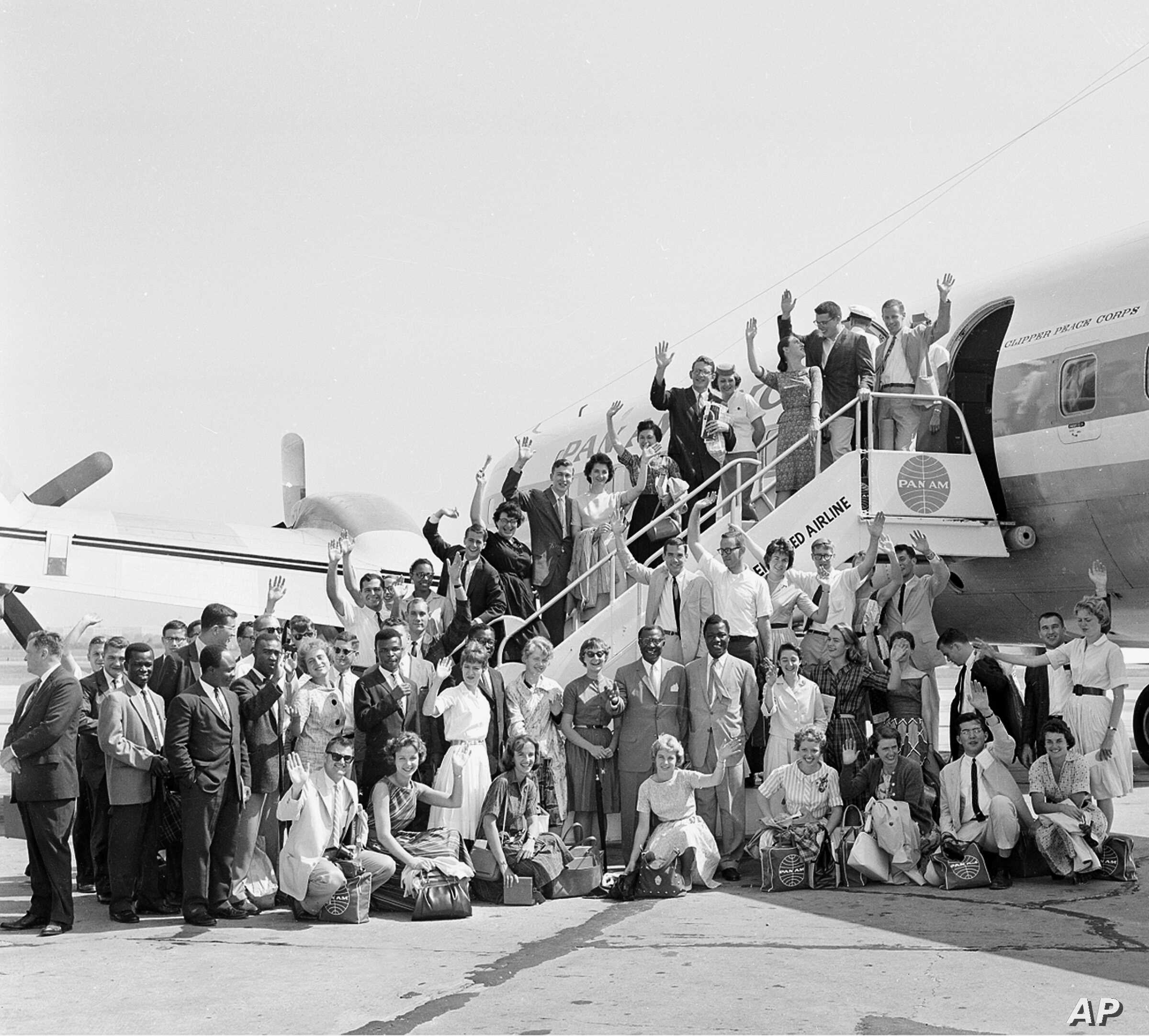 FILE - The first Peace Corps Volunteers to leave for overseas duty wave from the ramp of their plane at National Airport, Washington, D.C., Aug. 29, 1961, en route to teaching assignments in Ghana.  (AP Photo)