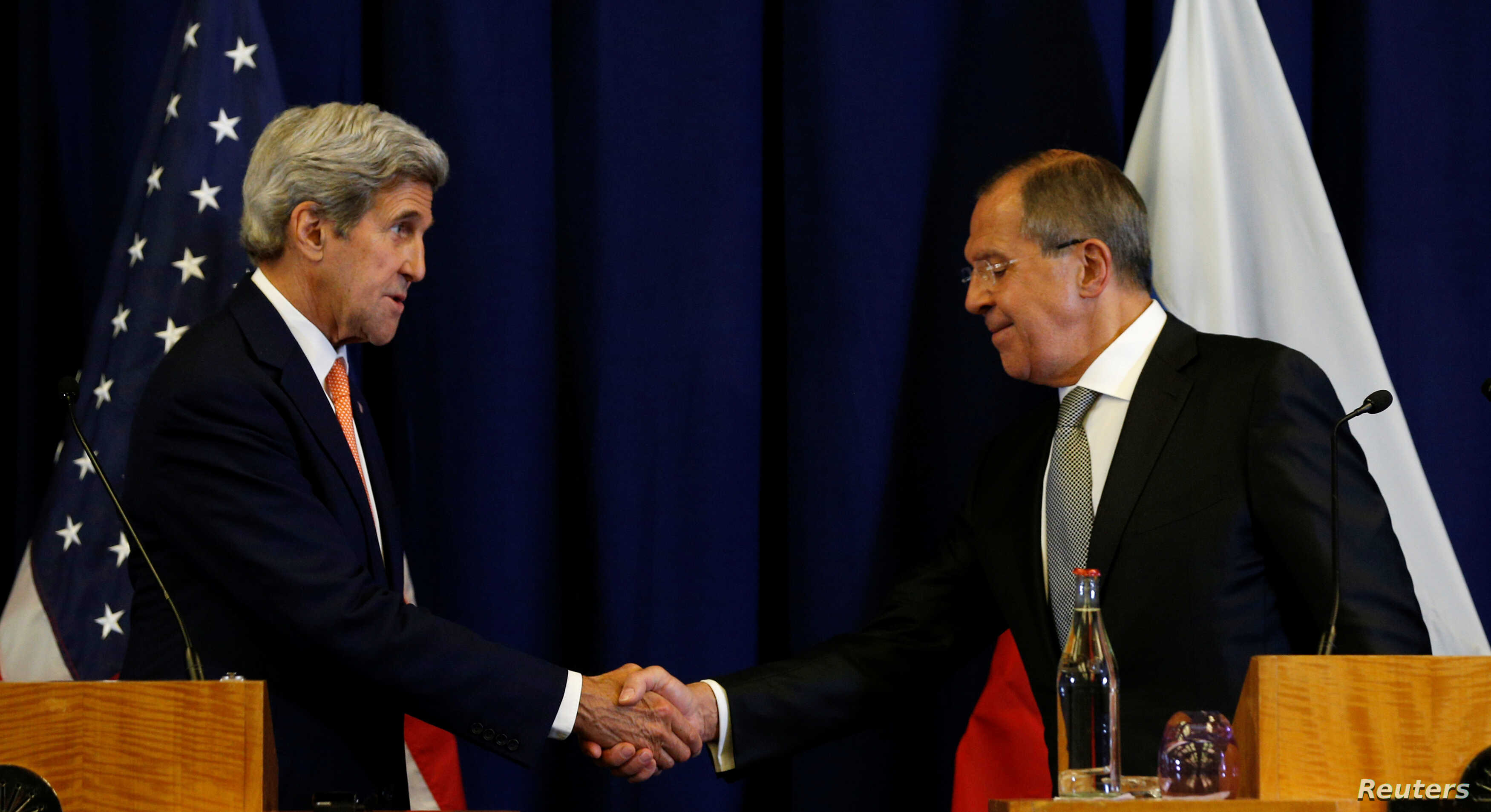 U.S. Secretary of State John Kerry and Russian Foreign Minister Sergei Lavrov shake hands at the conclusion of their press conference following their meeting in Geneva, Switzerland, Sept. 9, 2016.