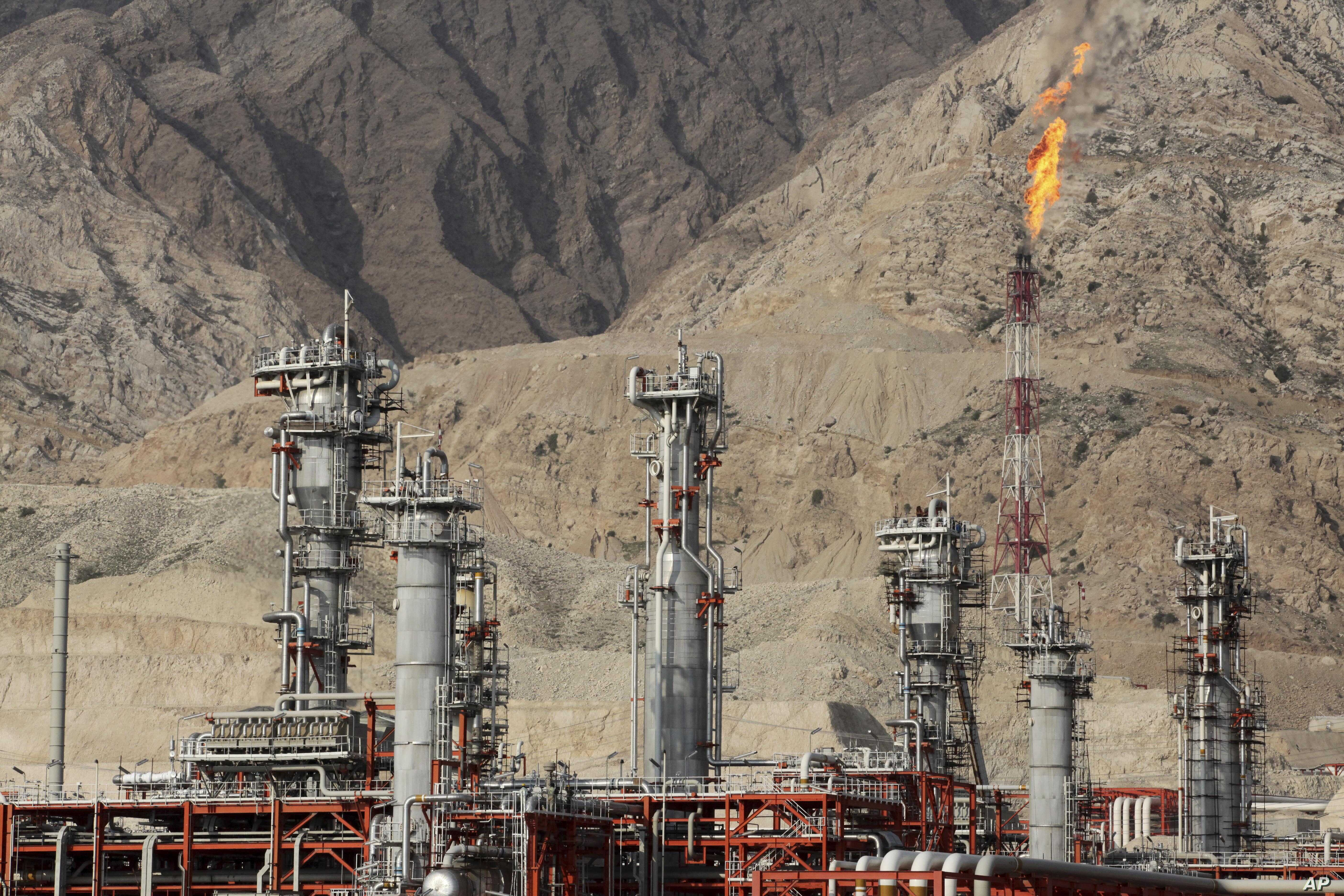 In this Jan. 22, 2014 photo, a gas flare burns in a gas refinery in South Pars gas field, on the northern coast of the Persian Gulf, in Asalouyeh, Iran.