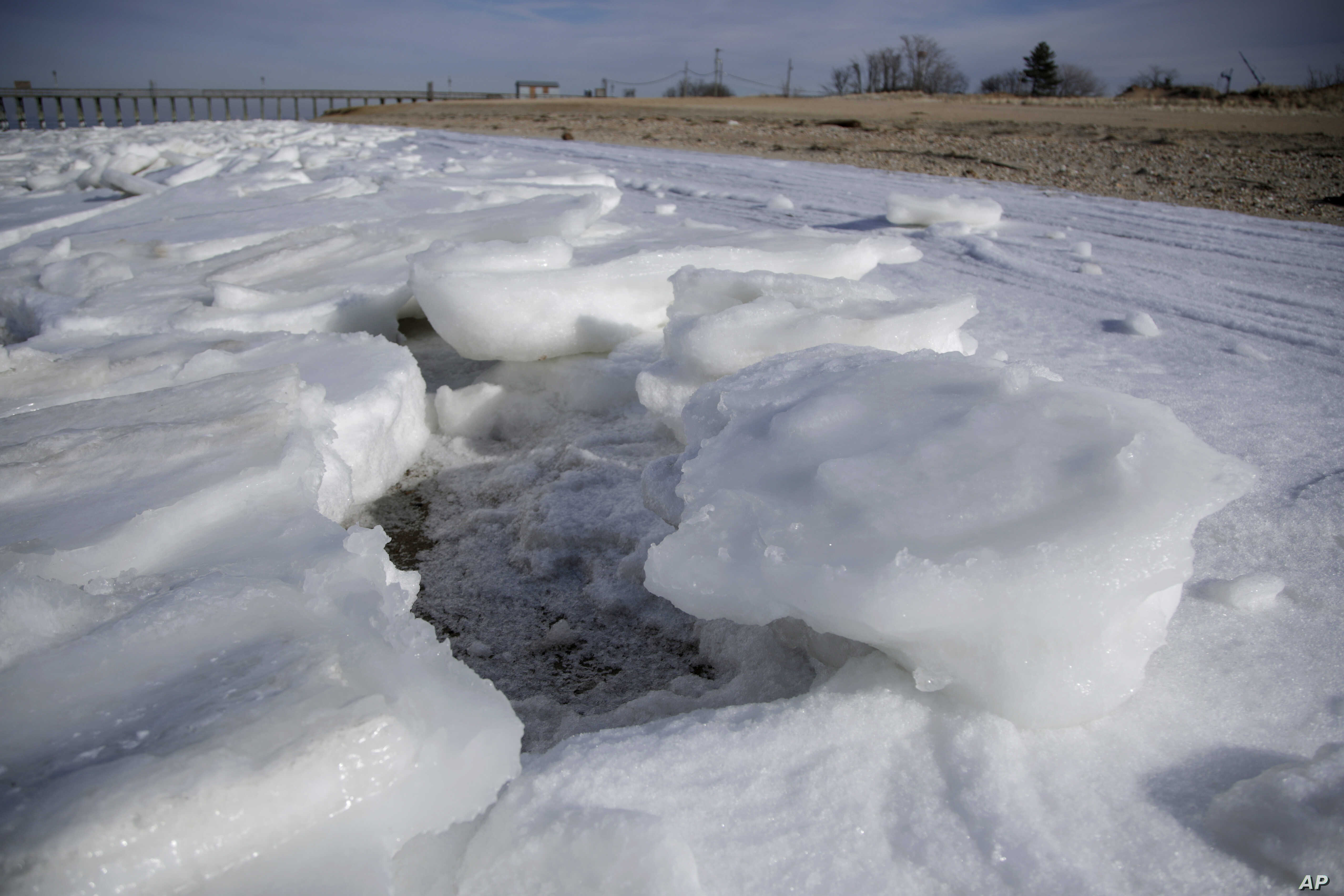 Chunks of ice forms along the shore of the Raritan Bay in the northern part of the New Jersey Shore,  Jan. 3, 2018, in Keansburg, New Jersey.