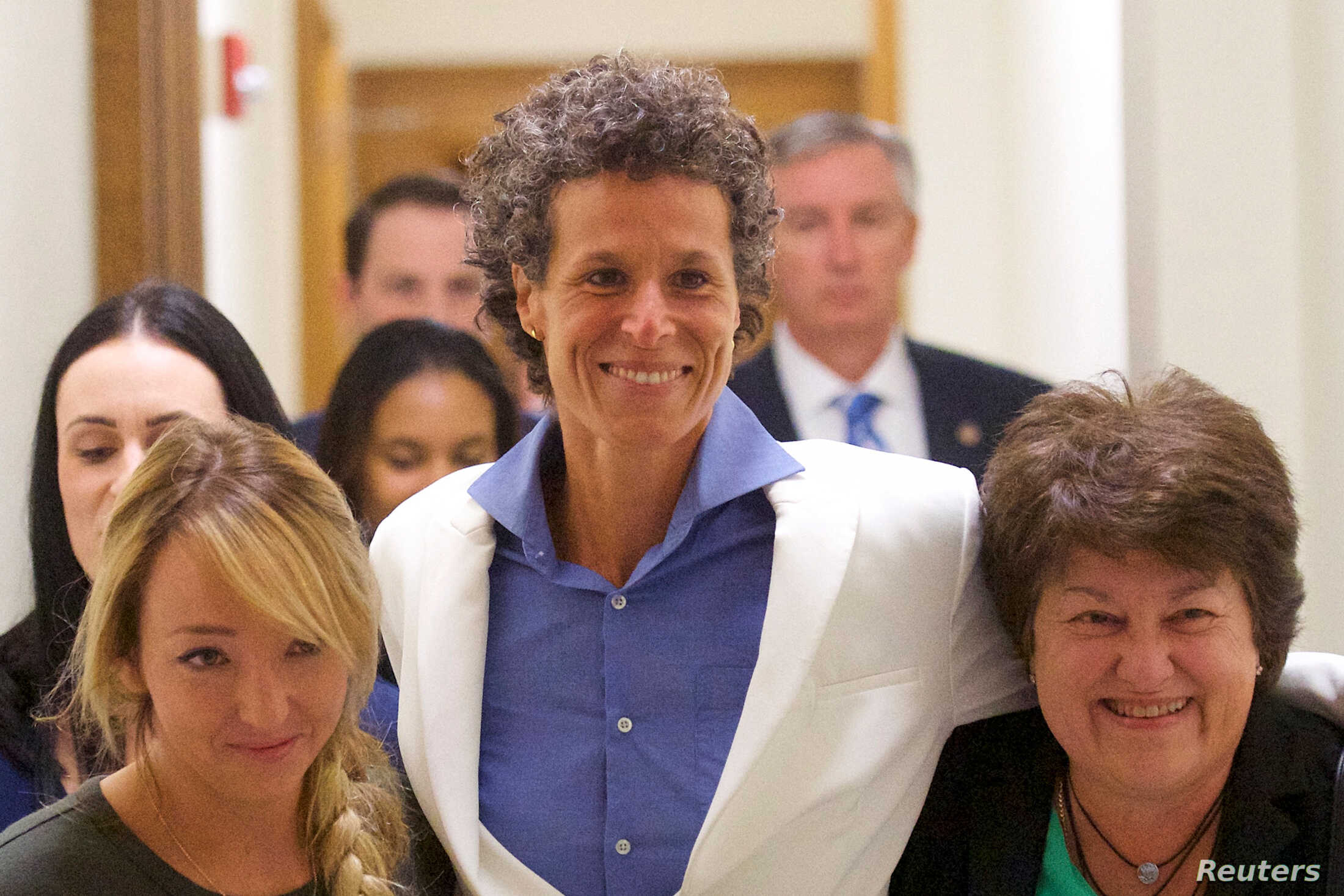 Bill Cosby accuser Andrea Constand, center, reacts after the guilty on all counts verdict was delivered in the sexual assault retrial at the Montgomery County Courthouse in Norristown, Pennsylvania, April 26, 2018.