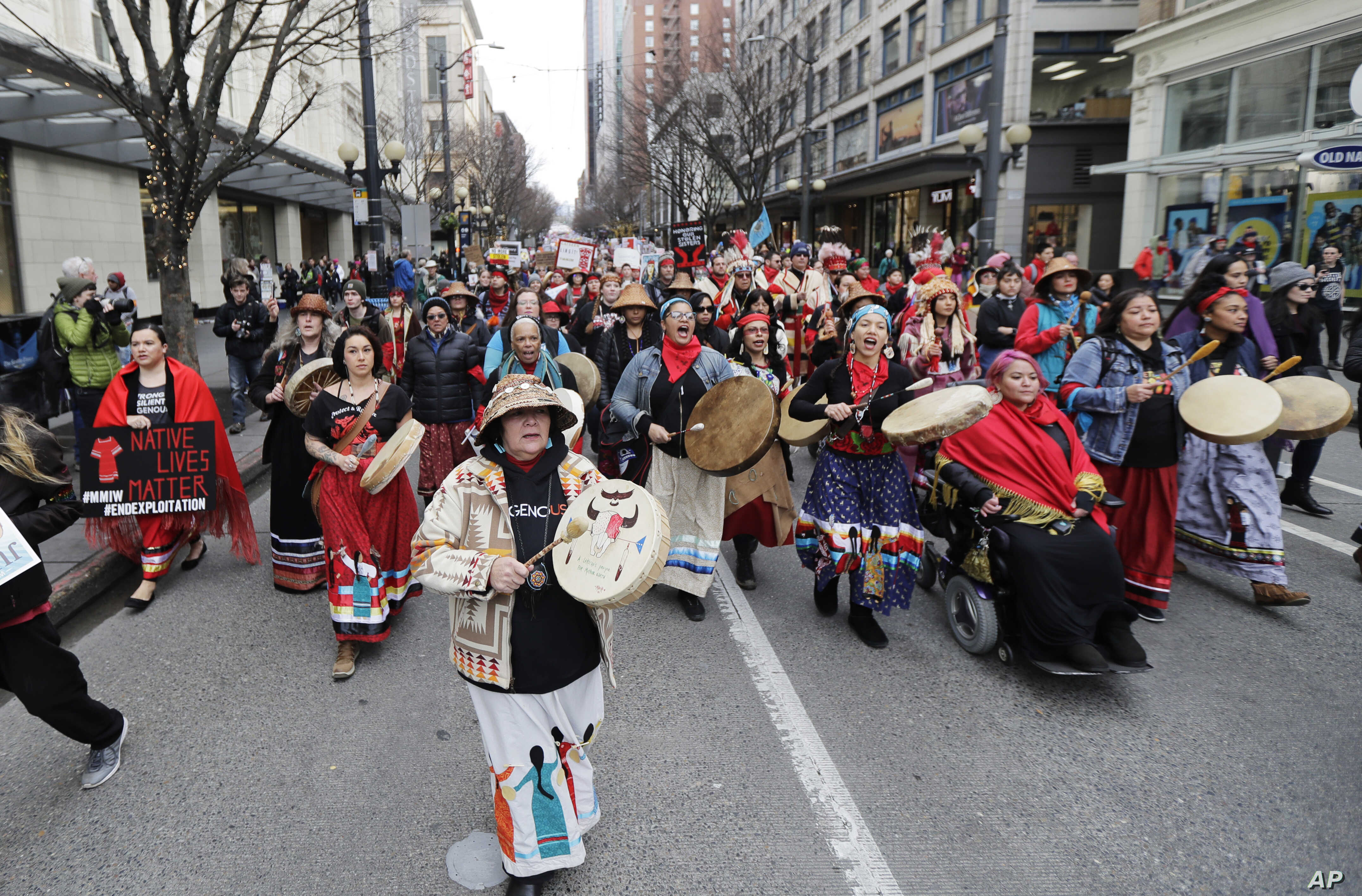 Native American drummers sing as they help lead the Women's March in Seattle, Jan. 19, 2019.