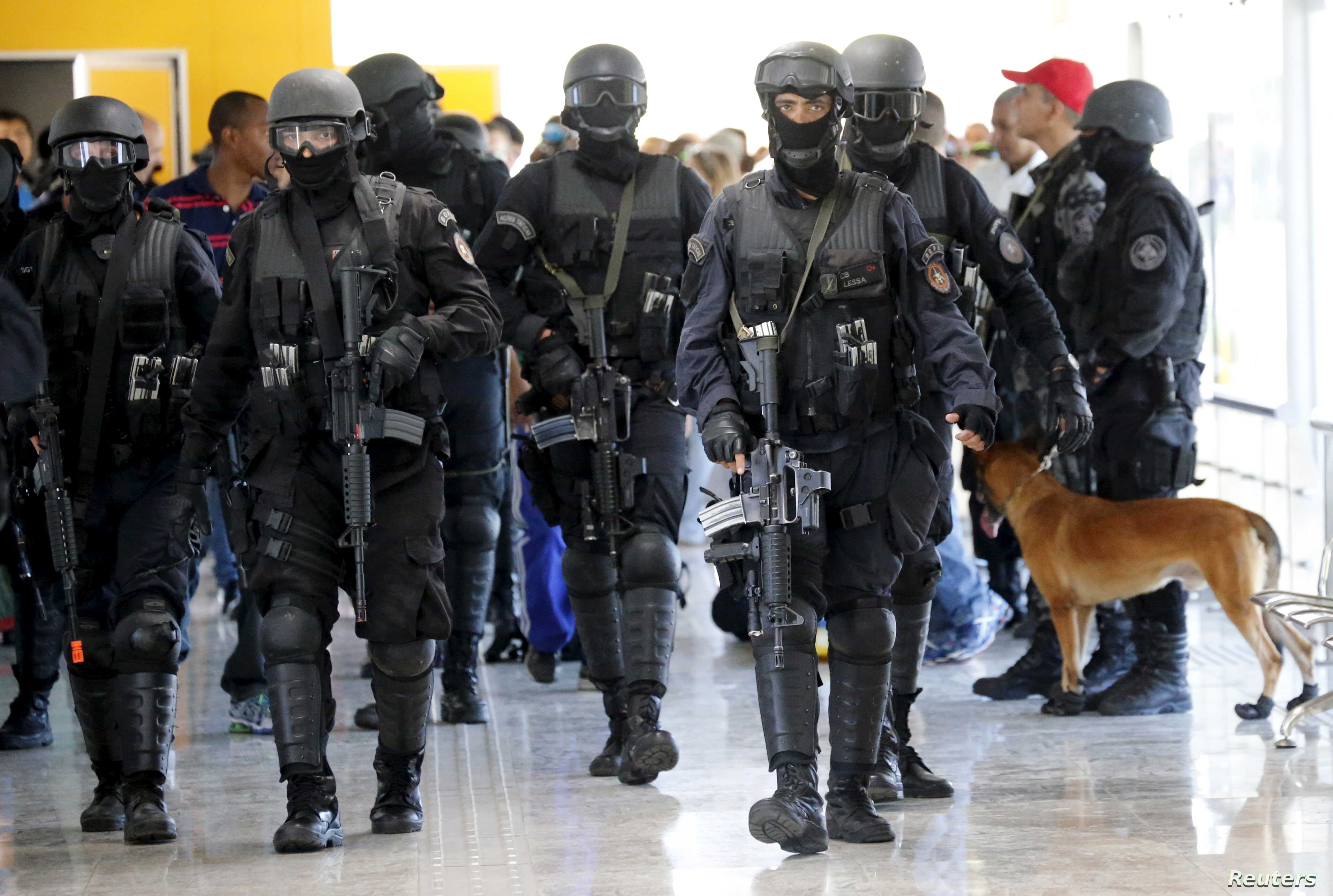FILE - Members of Brazil's Battalion of Special Operations (BOPE) participate during a crisis simulation exercise conducted by the BOPE to show the media how security will be provided during the 2016 Olympics at the Golf Olympic bus station in Rio de...