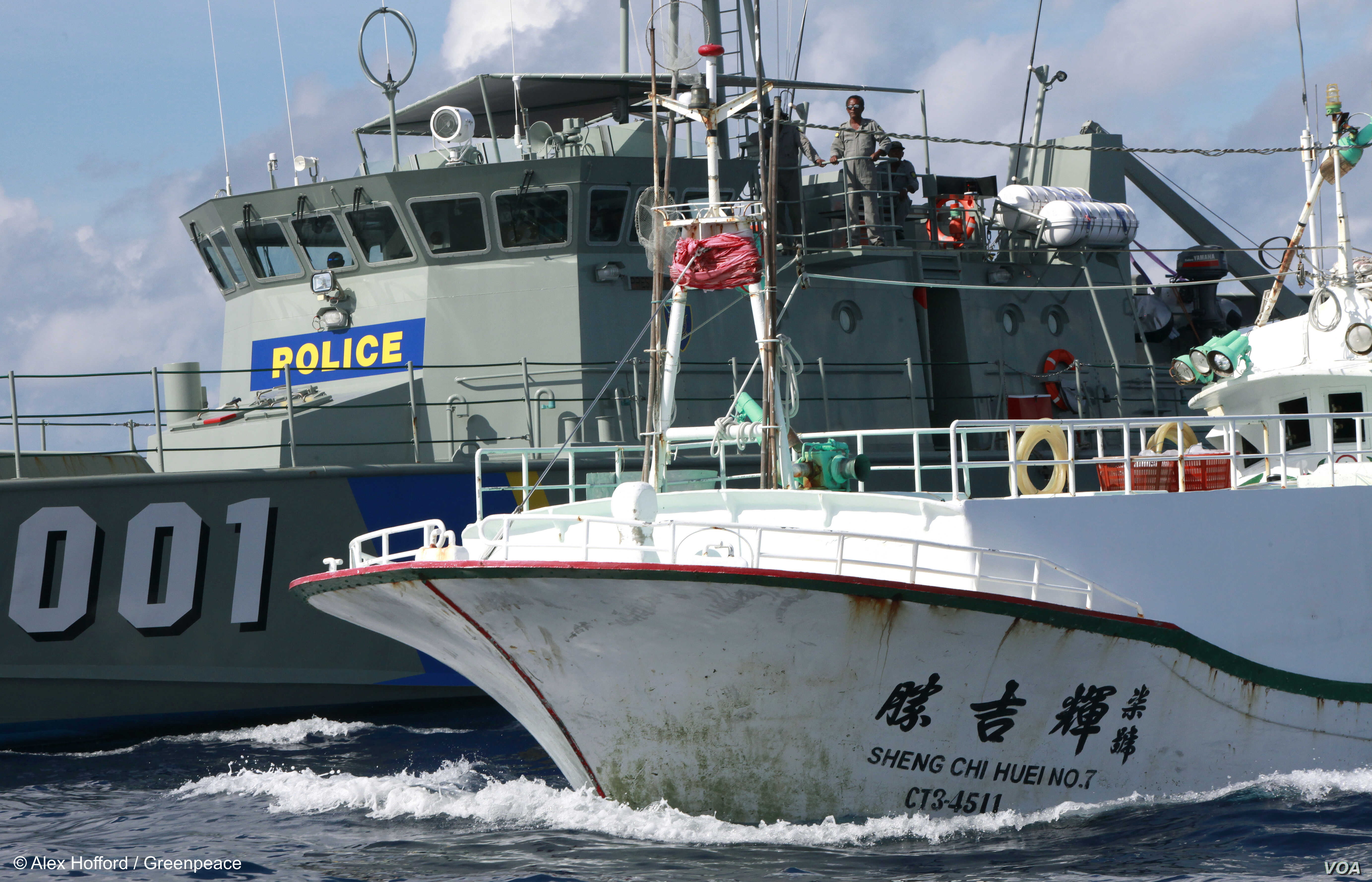 A Paluan law enforcement ship suspects a Taiwanese long line fishing vessel of illegal shark finning in Palau's Exclusive Economic Zone, in violation of Palau's law banning such fishing. (Alex Hofford/Greenpeace)
