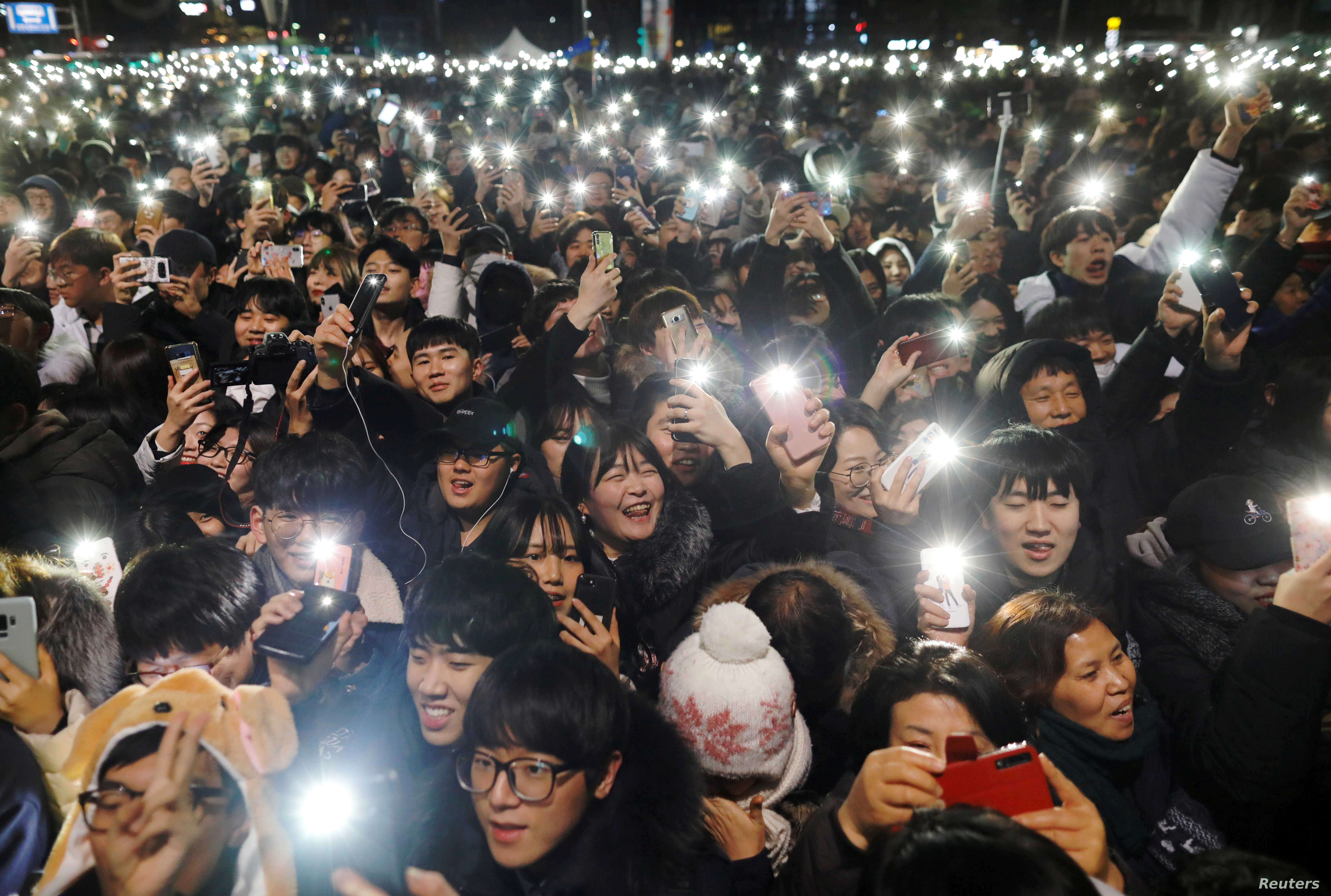 People attend a ceremony to celebrate the new year in Seoul, South Korea, Jan. 1, 2019.