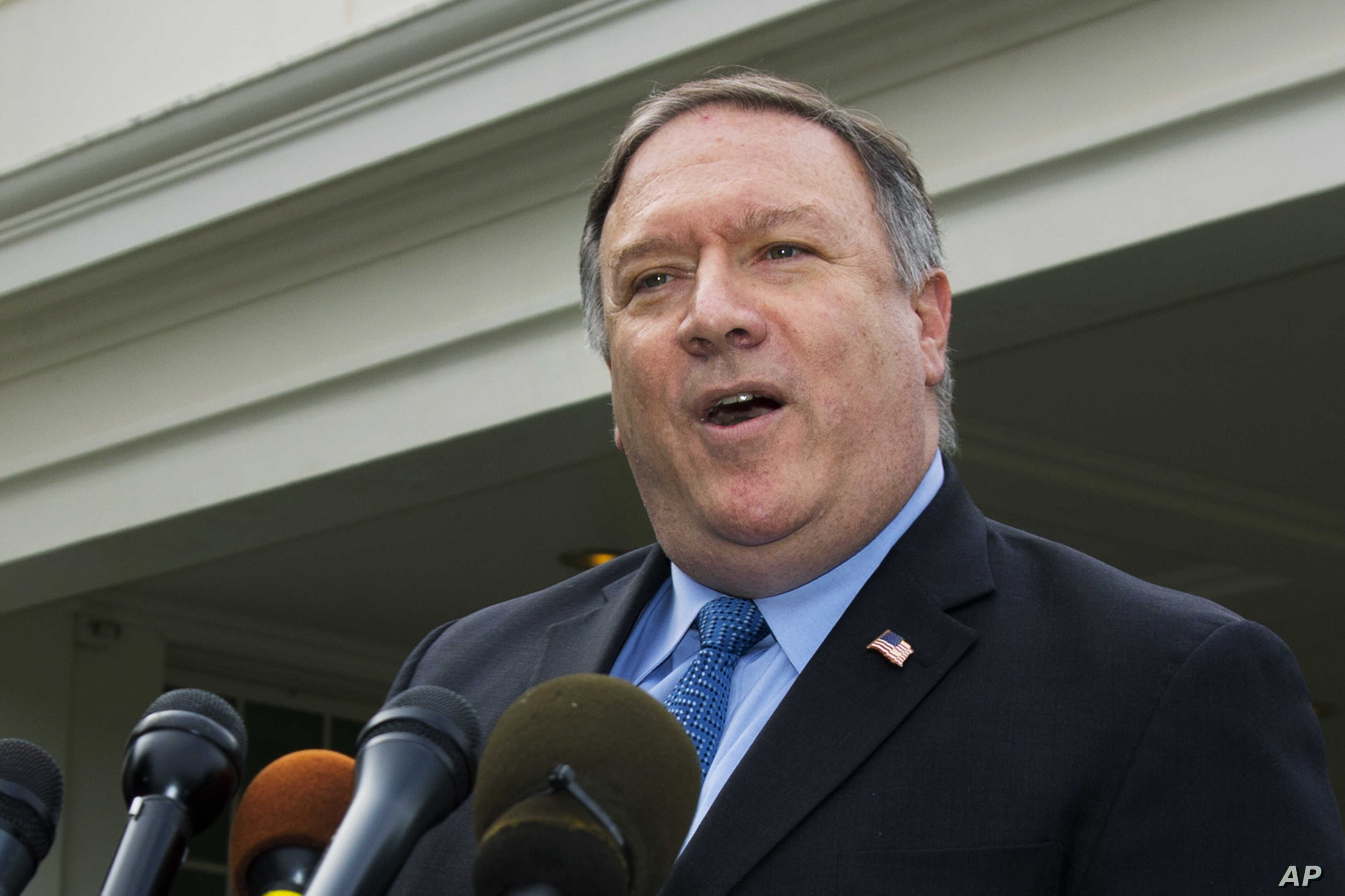 U.S. Secretary of State Mike Pompeo speaks to reporters outside the White House in Washington, Oct. 9, 2018.
