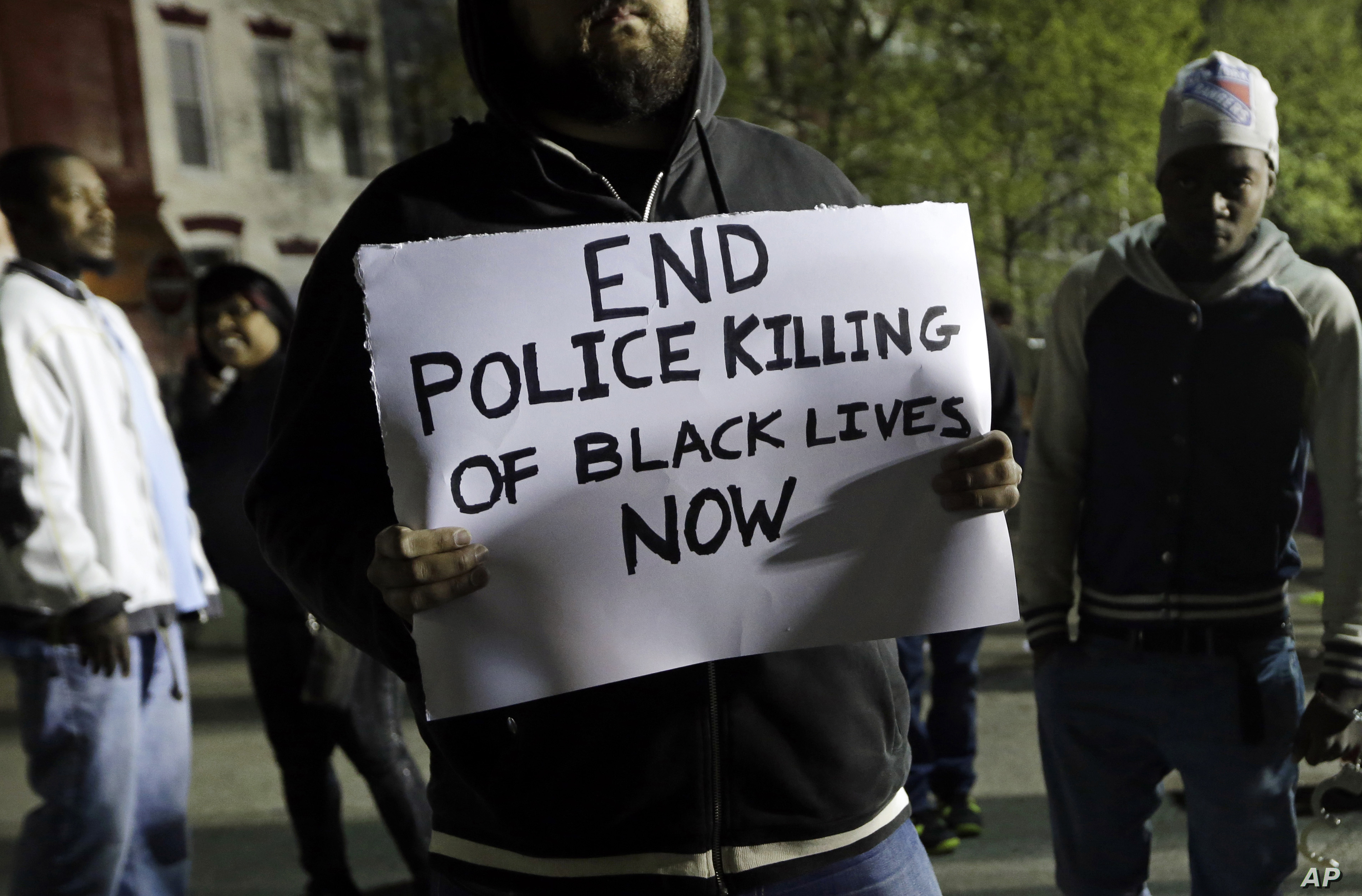 A protester outside the Baltimore Police Department's Western District police station, April 23, 2015, in Baltimore.