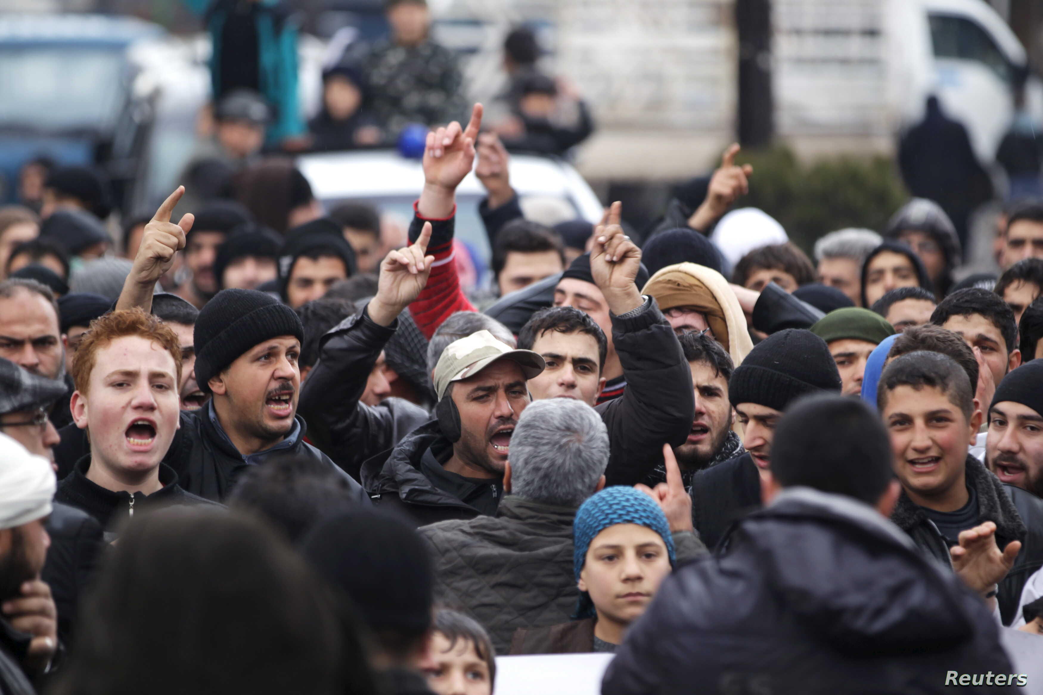 People shout slogans during a protest after Friday prayers, calling for the lifting of the siege off Madaya, in the rebel-controlled area of Maaret al-Numan town in Idlib province, Syria, Jan. 8, 2016.