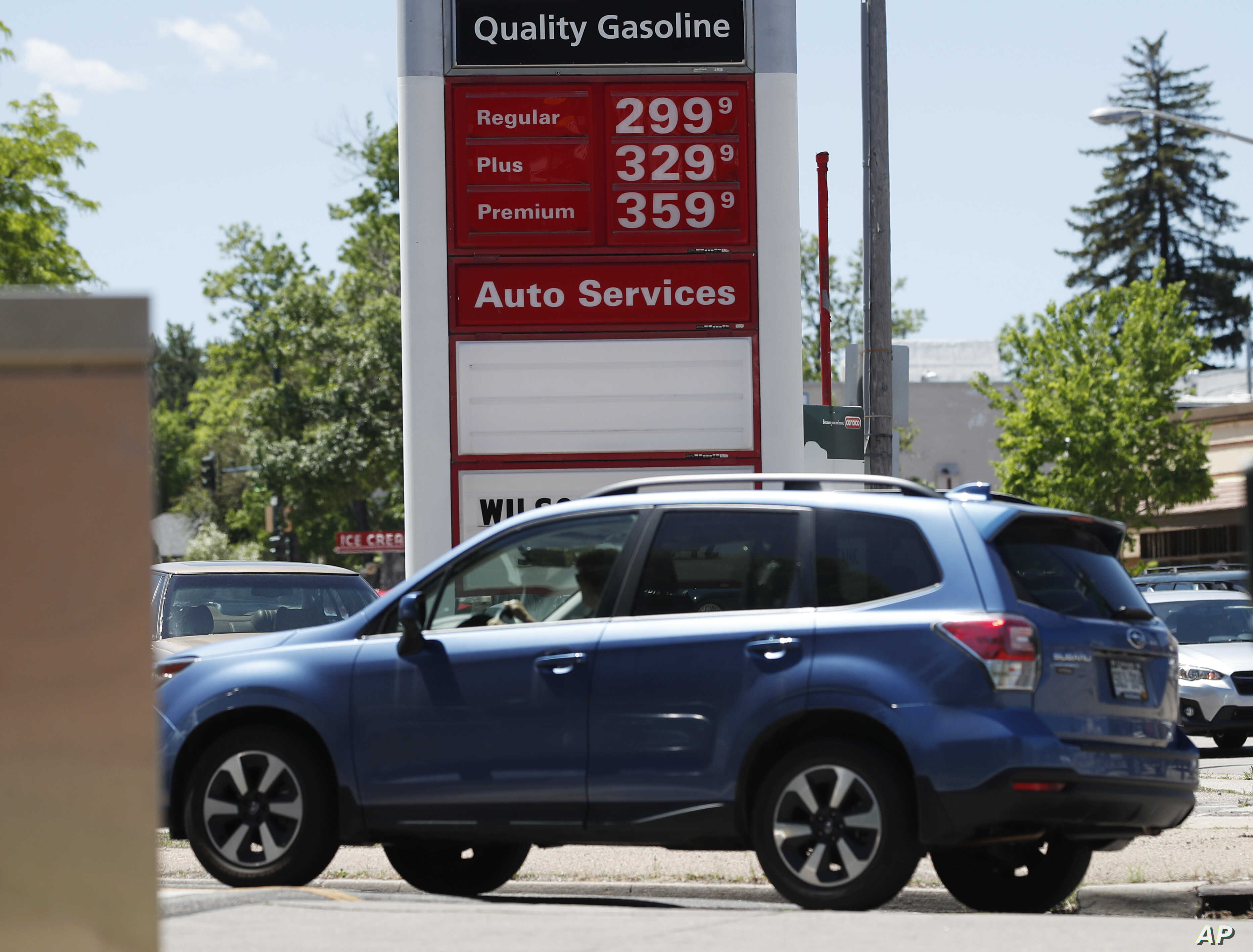 Prices for the three grades of gasoline light up the pump at a Conoco station, May 25, 018, in east Denver. Memorial Day vacationers are facing the highest prices at the pumps since 2014 as the average cost of a gallon of regular unleaded is just les...