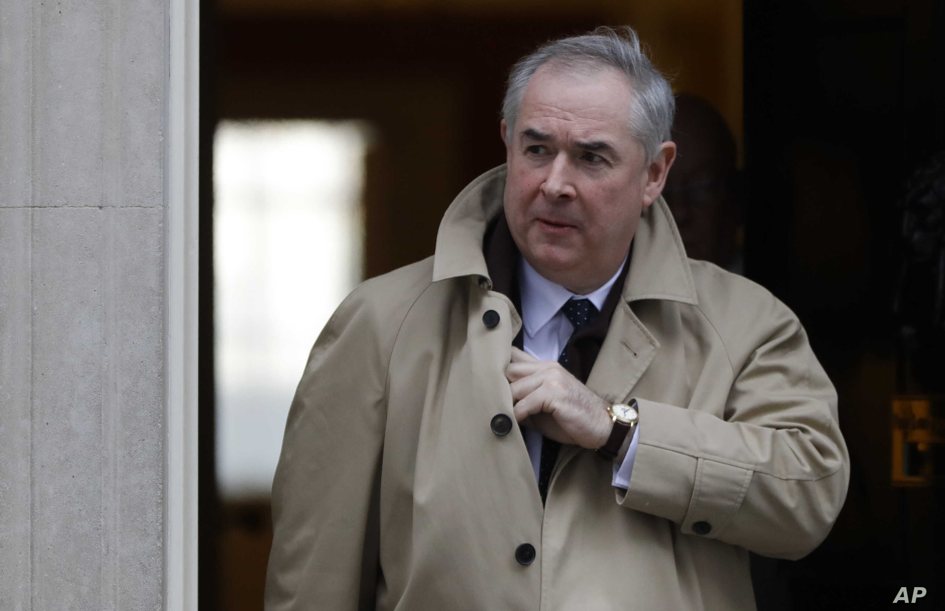 British Attorney General Geoffrey Cox leaves after a cabinet meeting at Downing Street in London, Jan. 29, 2019.