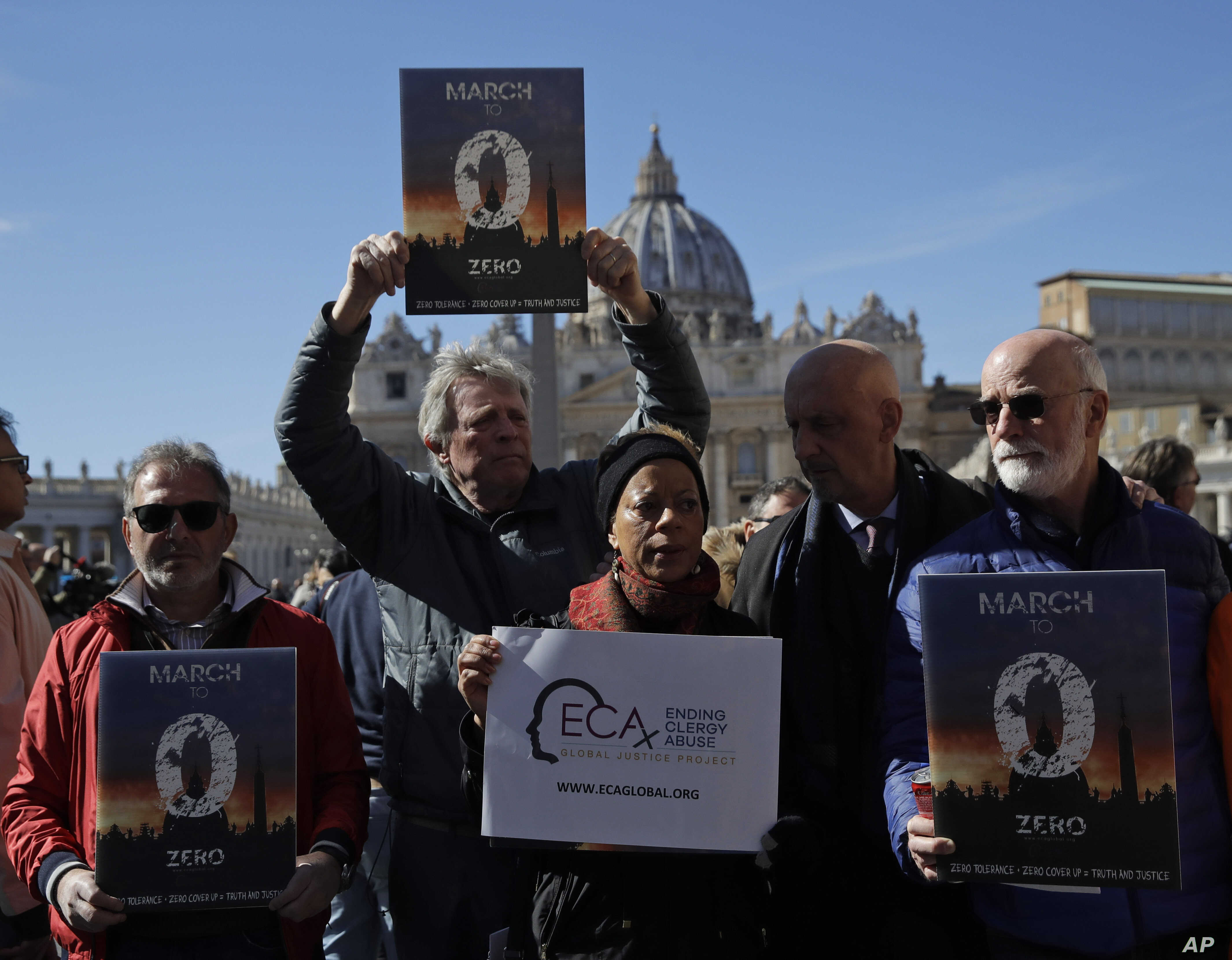 Sex abuse survivors and members of ECA (Ending Clergy Abuse), show banners in front of St. Peter's Square at the Vatican as they meet reporters, Feb. 24, 2019.