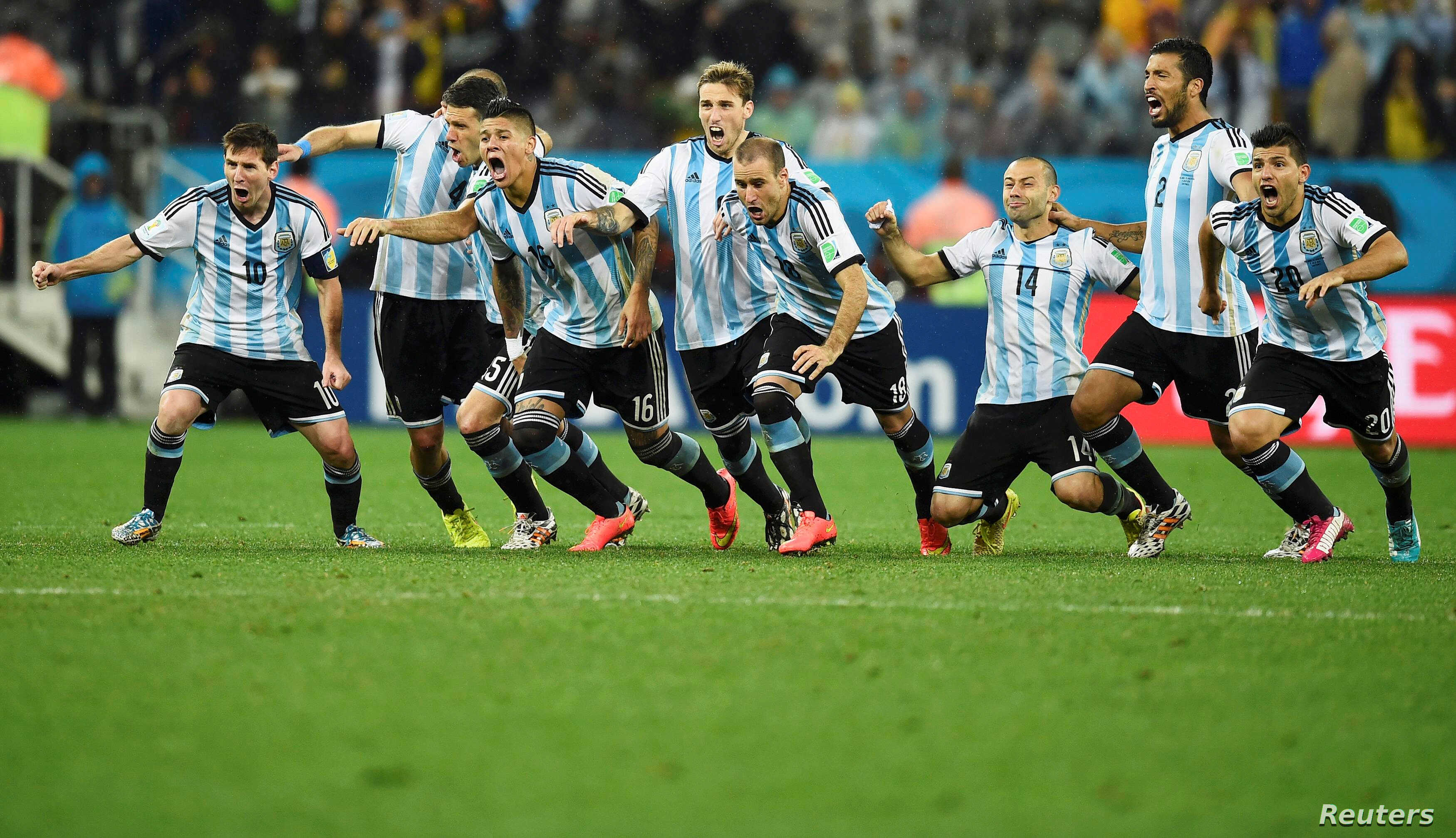 FILE - Argentina's national soccer players celebrate after their teammate Maxi Rodriguez scored the decisive goal during a shootout against the Netherlands at their 2014 World Cup semi-finals in Sao Paulo, July 9, 2014.
