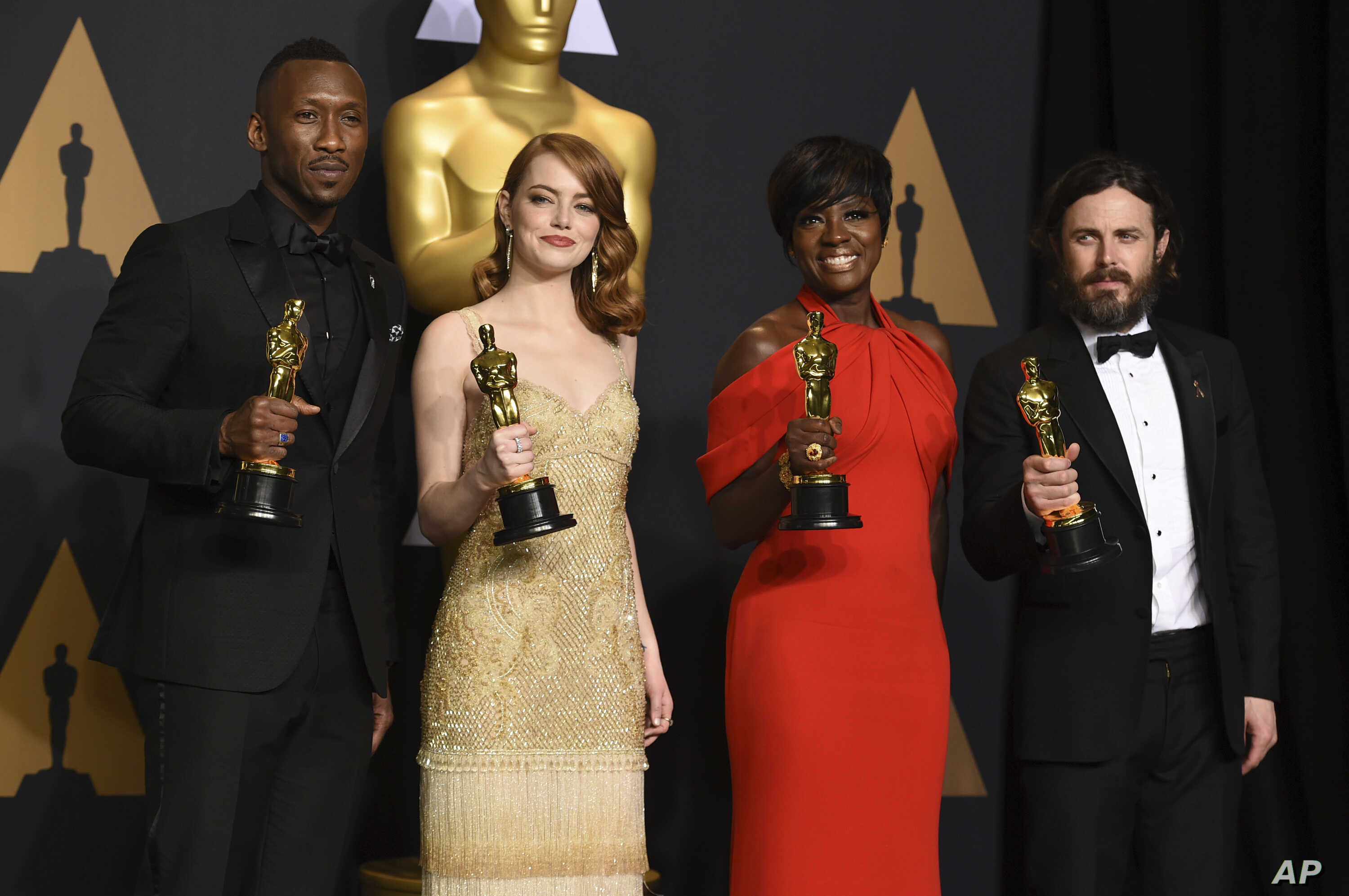 """Mahershala Ali, winner of the award for best actor in a supporting role for """"Moonlight"""", from left, Emma Stone, winner of the award for best actress in a leading role for """"La La Land"""", Viola Davis, winner of the award for best actress in a supporting..."""