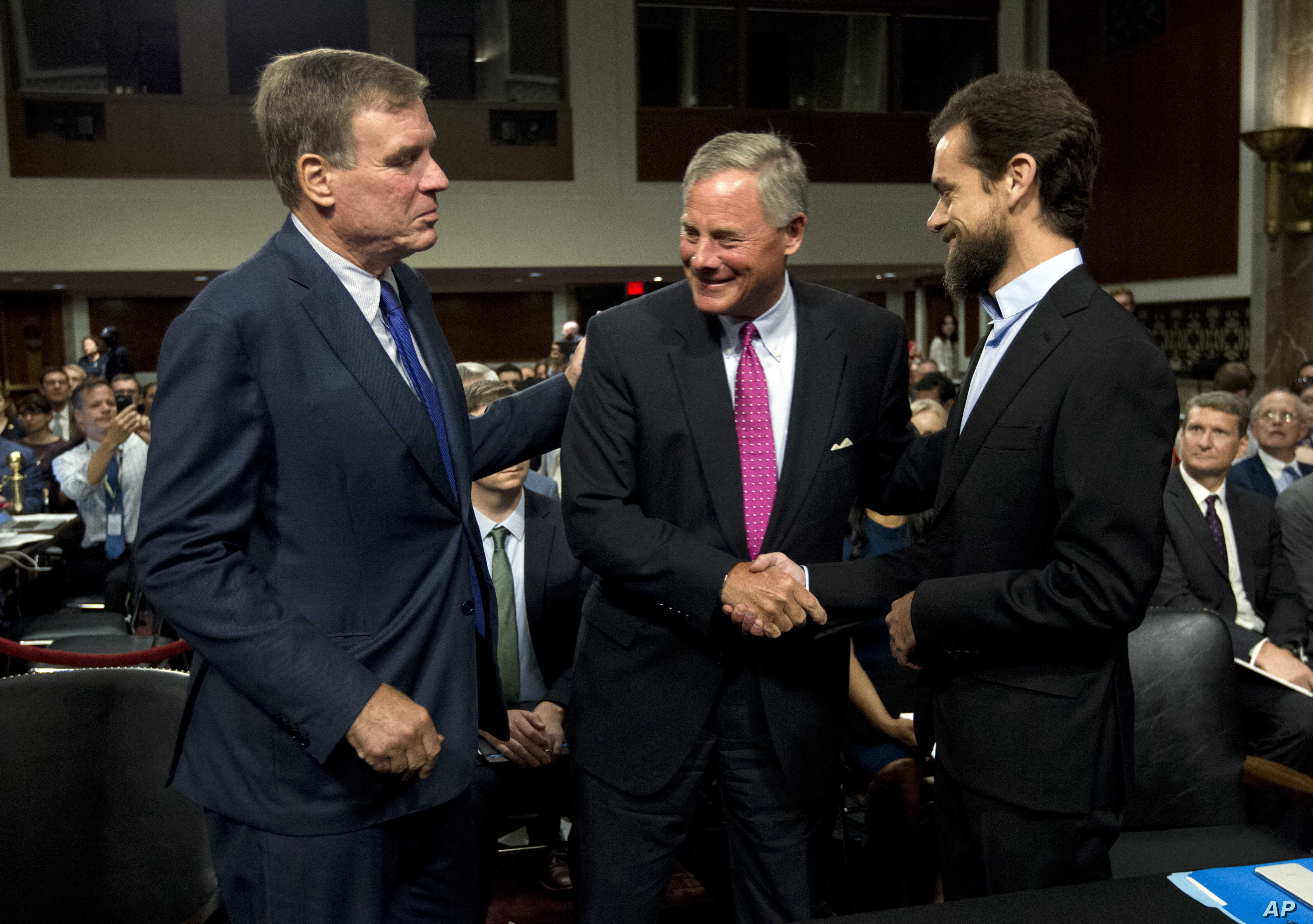 Senate Intelligence Committee Vice Chairman Mark Warner, D-Va., (L) and Chairman Sen. Richard Burr, R-N.C. (C) greet Twitter CEO Jack Dorsey before he testifies before the Senate Intelligence Committee hearing on 'Foreign Influence Operations and The...