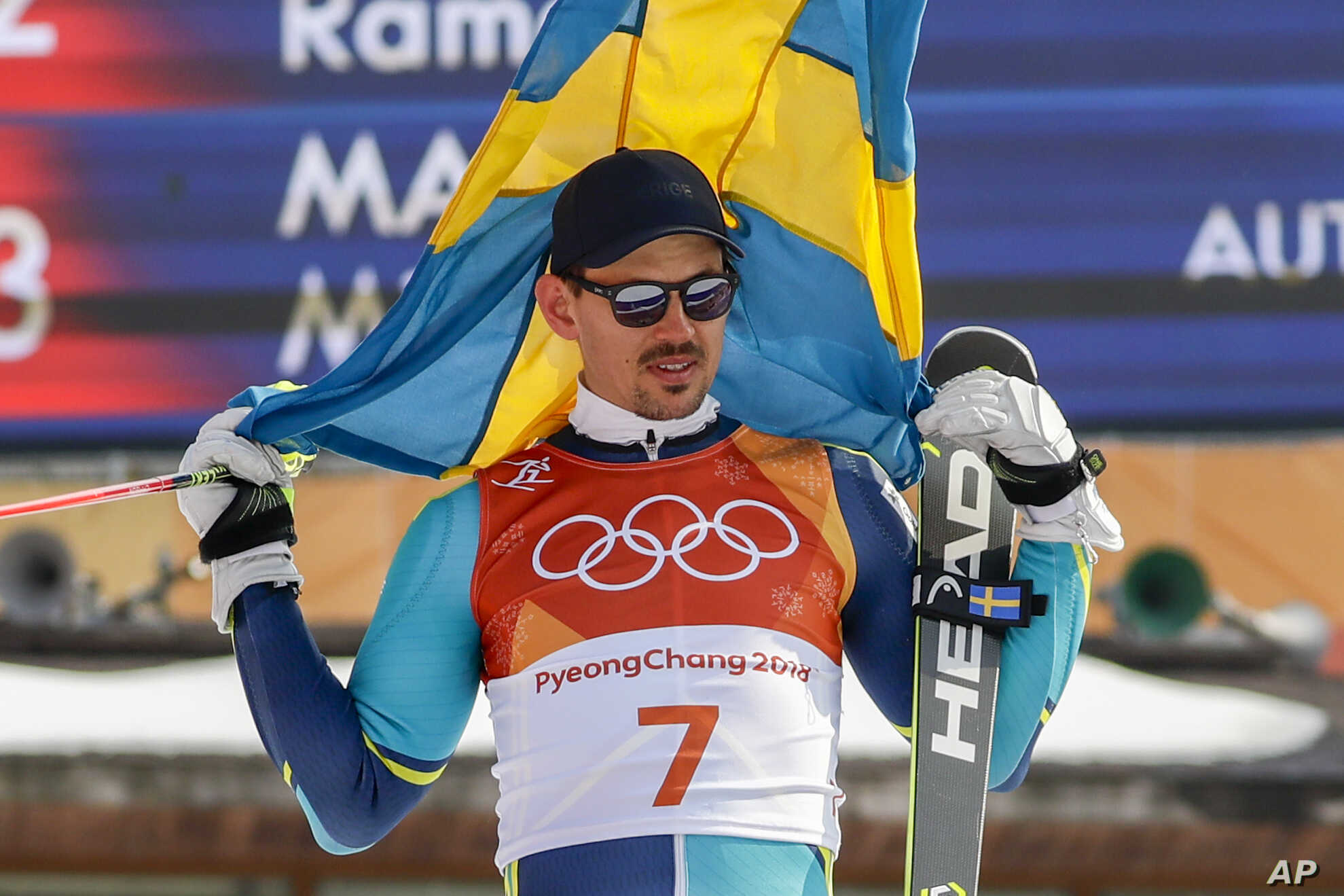 Andre Myhrer, of Sweden, celebrates his gold medal during the venue ceremony after the men's slalom at the 2018 Winter Olympics in Pyeongchang, South Korea, Feb. 22, 2018.