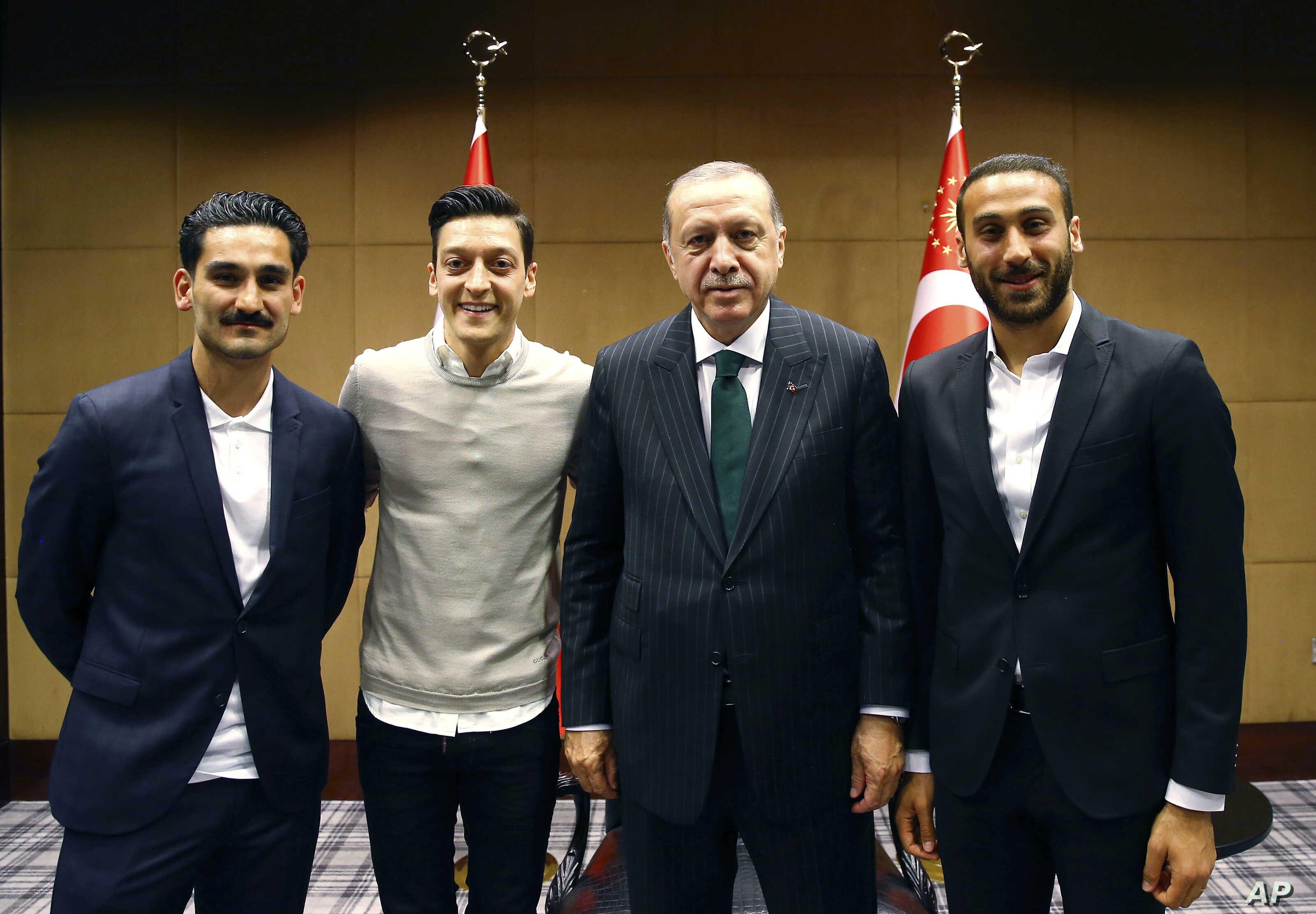 FILE - Turkey's President Recep Tayyip Erdogan, right, poses for a photo with soccer players Ilkay Gundogan, left, Mesut Ozil, center, in London, May 13, 2018.