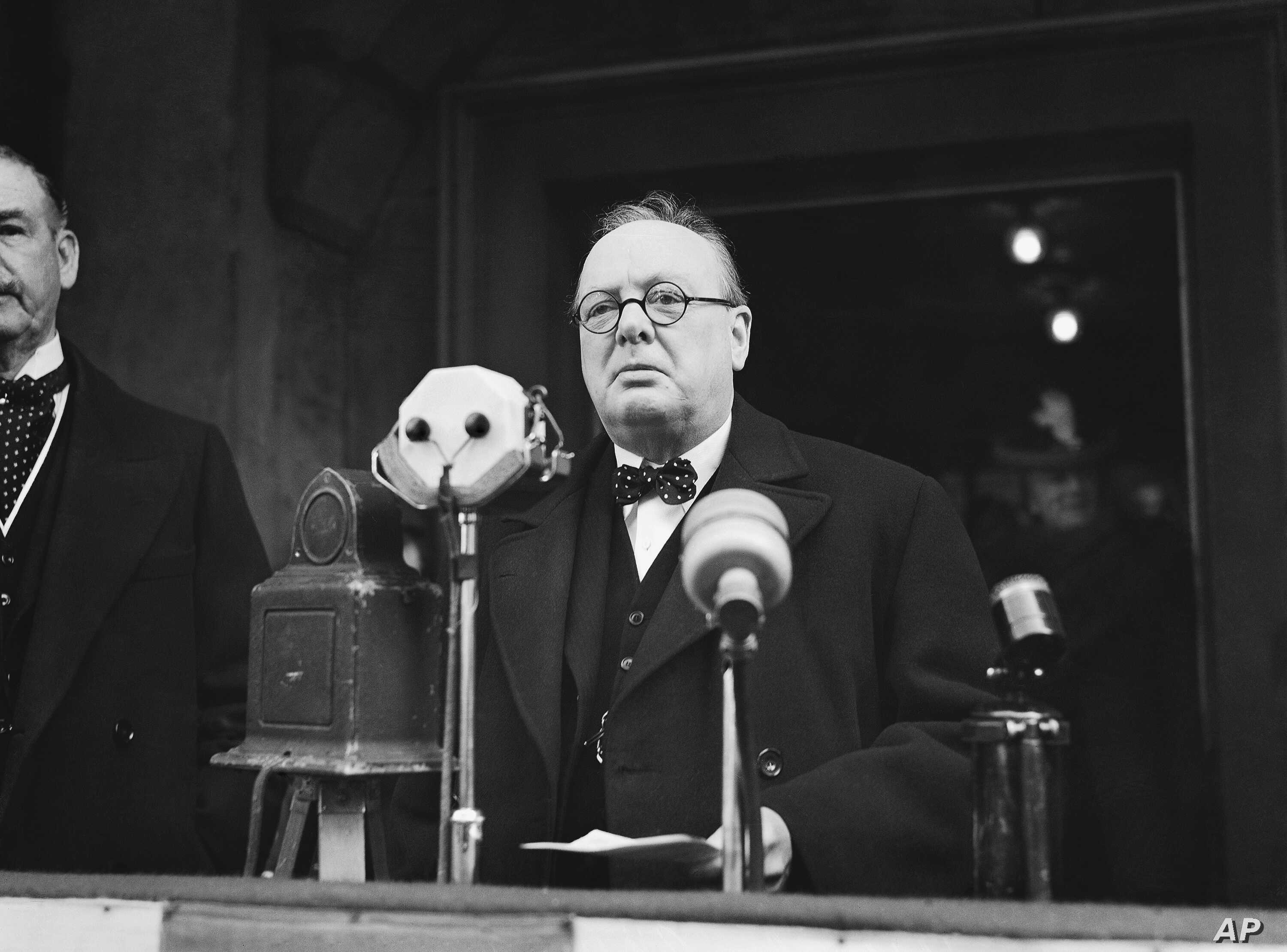 FILE - Winston Churchill approaches microphones to make a speech in January 1939. The British wartime leader played a principal role in drafting the European Convention on Human Rights.
