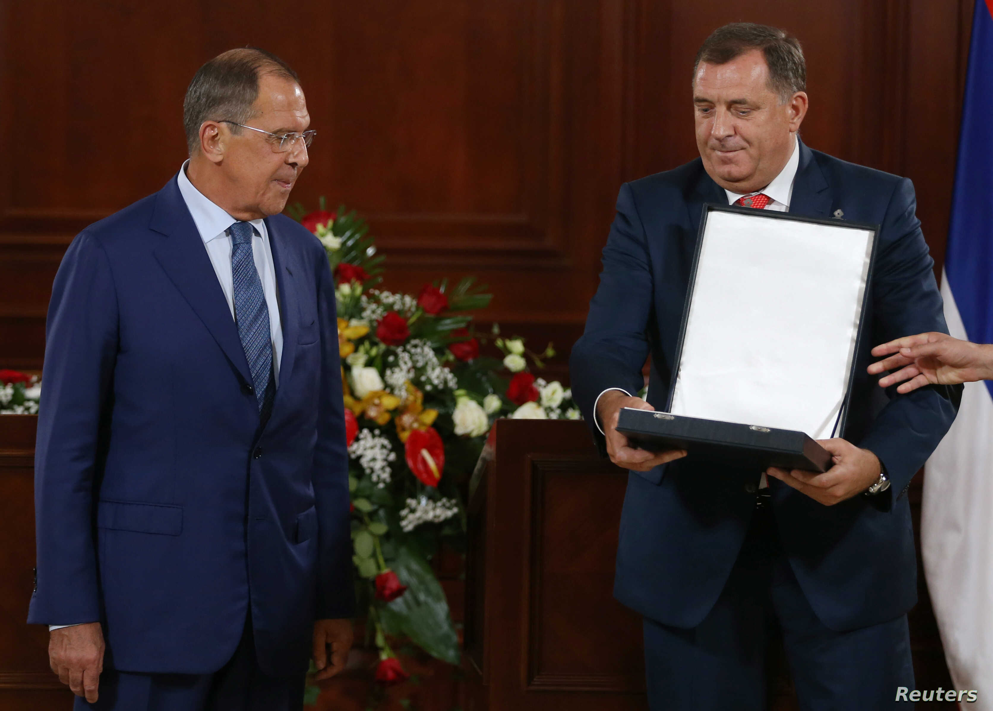 President of the Republika Srpska, Milorad Dodik awards Russia's Foreign Minister Sergei Lavrov with  Order of the Republika Srpska, after their meeting in Banja Luka, Bosnia and Herzegovina, Sept. 21, 2018.