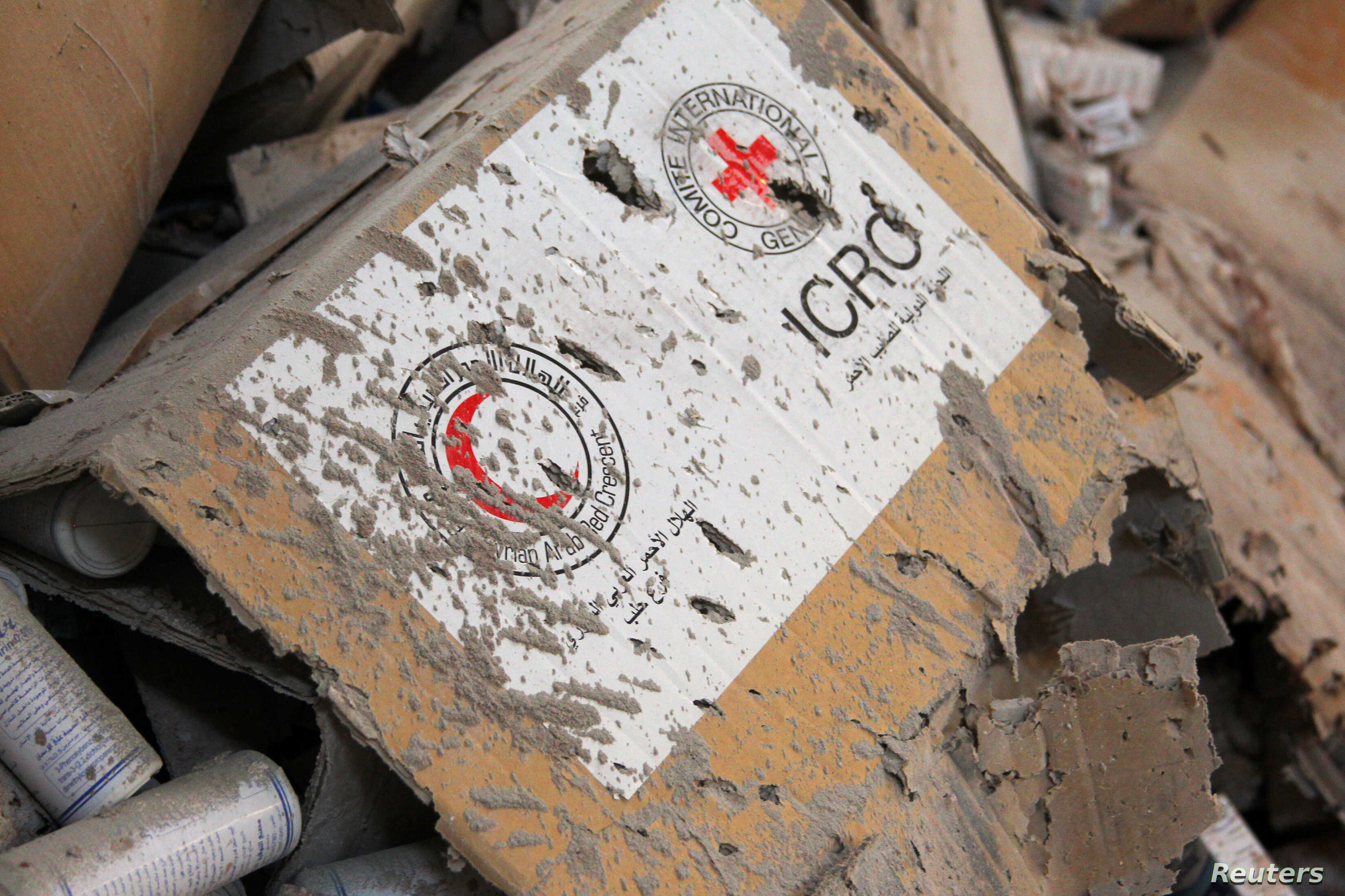 Damaged Red Cross and Red Crescent medical supplies lie inside a warehouse after an airstrike on the rebel held Urm al-Kubra town, western Aleppo city, Syria Sept. 20, 2016.