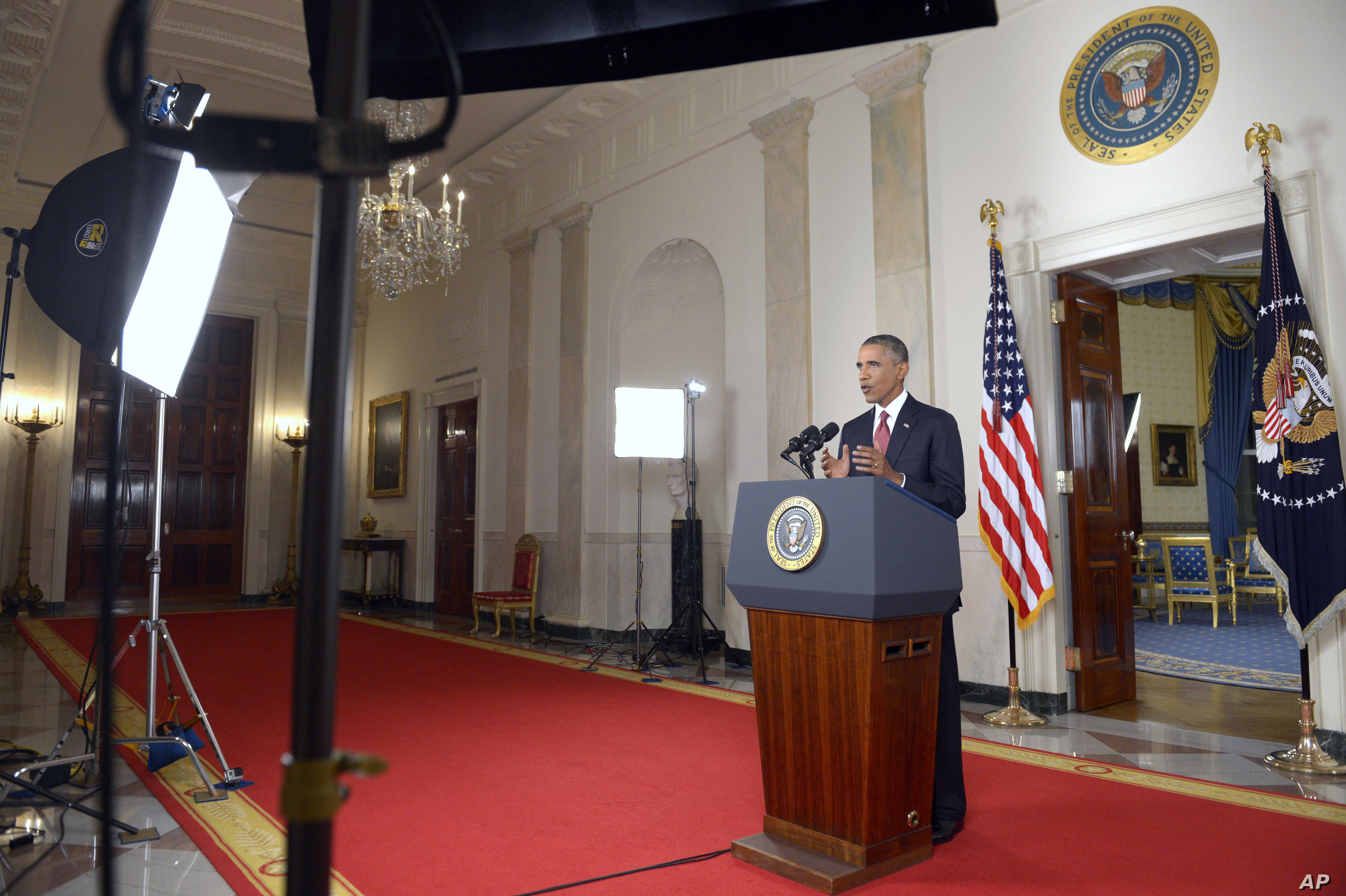 """President Barack Obama addresses the nation from the Cross Hall in the White House in Washington, Wednesday, Sept. 10, 2014. In a major reversal, Obama ordered the United States into a broad military campaign to """"degrade and ultimately destroy"""" milit"""