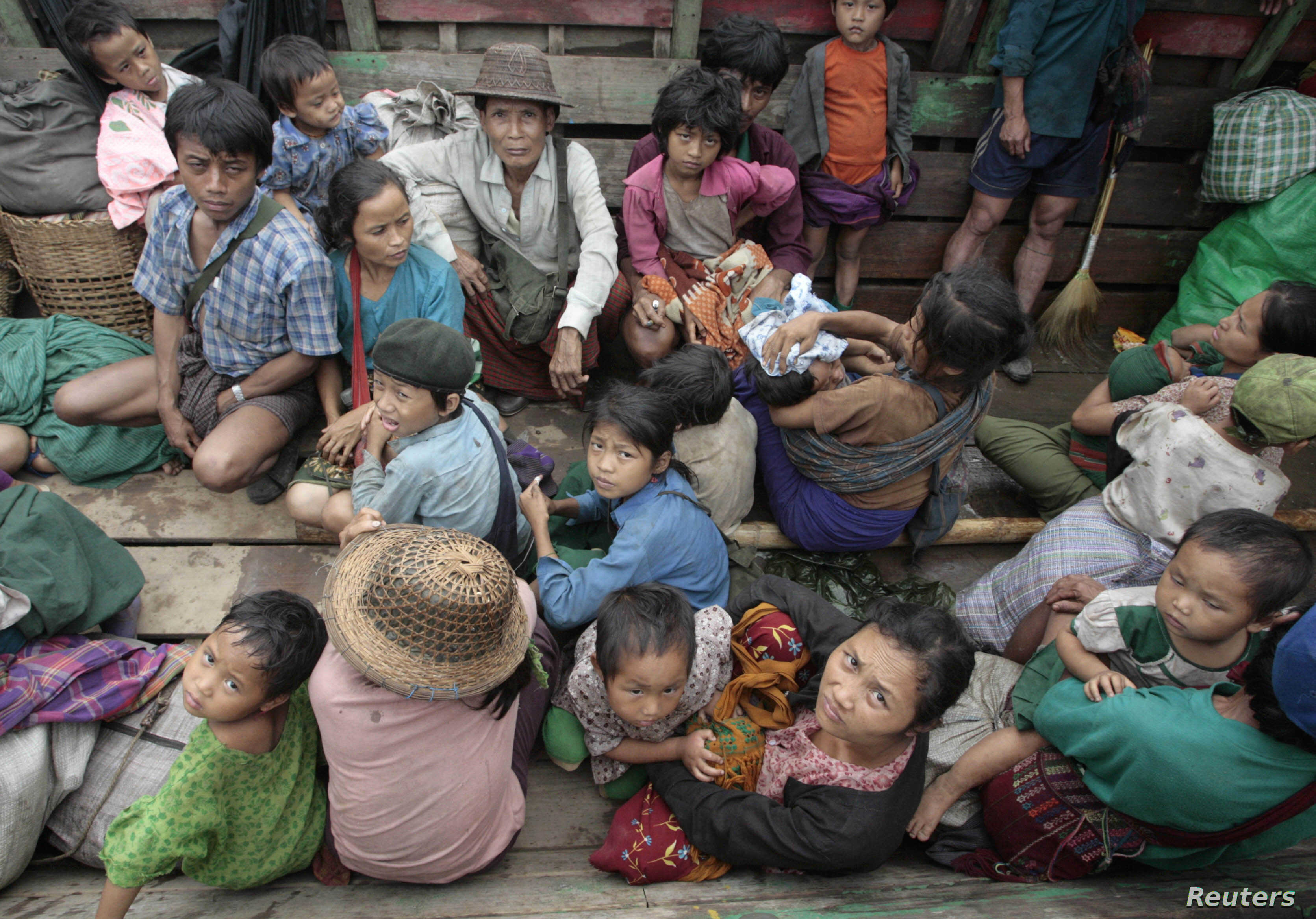 FILE - A boatload of ethnic Karen refugees wait for Thai authorities to let them into a refugee camp in Mae Hon Son province, north of Bangkok, June 6, 2007.