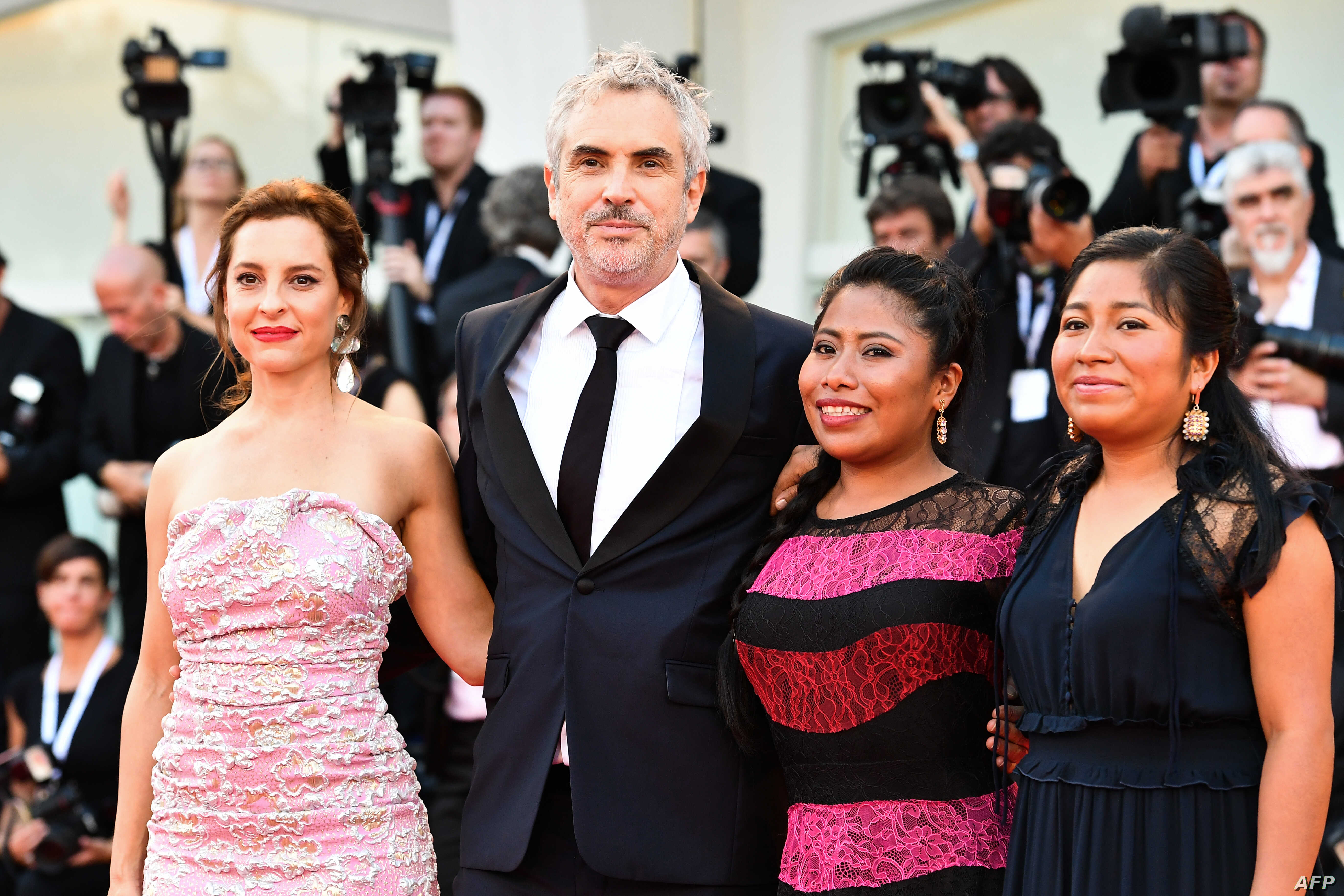 "(From L) Actress Marina de Tavira, director Alfonso Cuaron, actress Yalitza Aparicio and actress Nancy Garcia arrive for the premiere of the film ""Roma"" presented in competition, Aug. 30, 2018, during the 75th Venice Film Festival at Venice Lido."