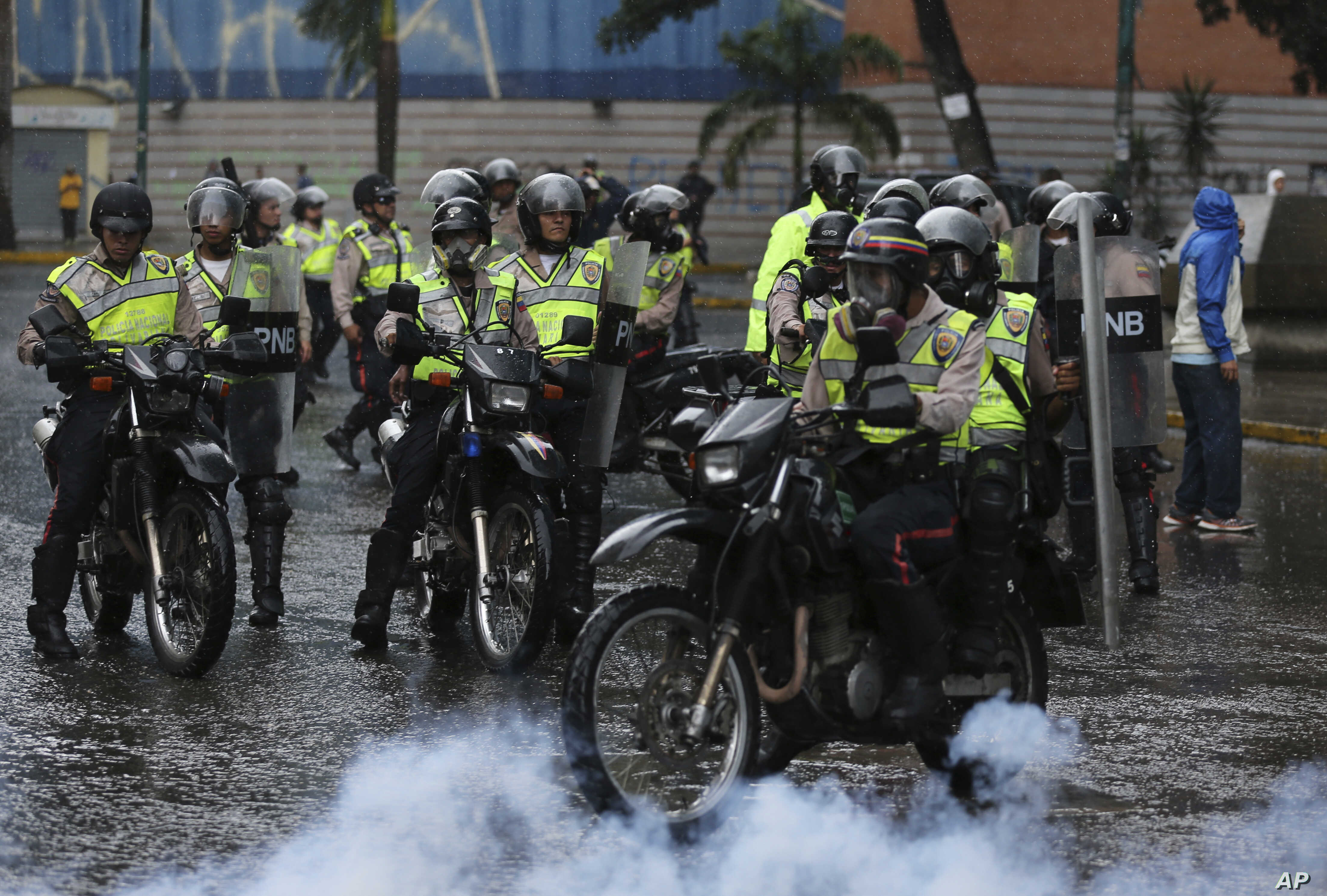 Police ride in to clear a protest in Caracas, Venezuela, June 28, 2017.