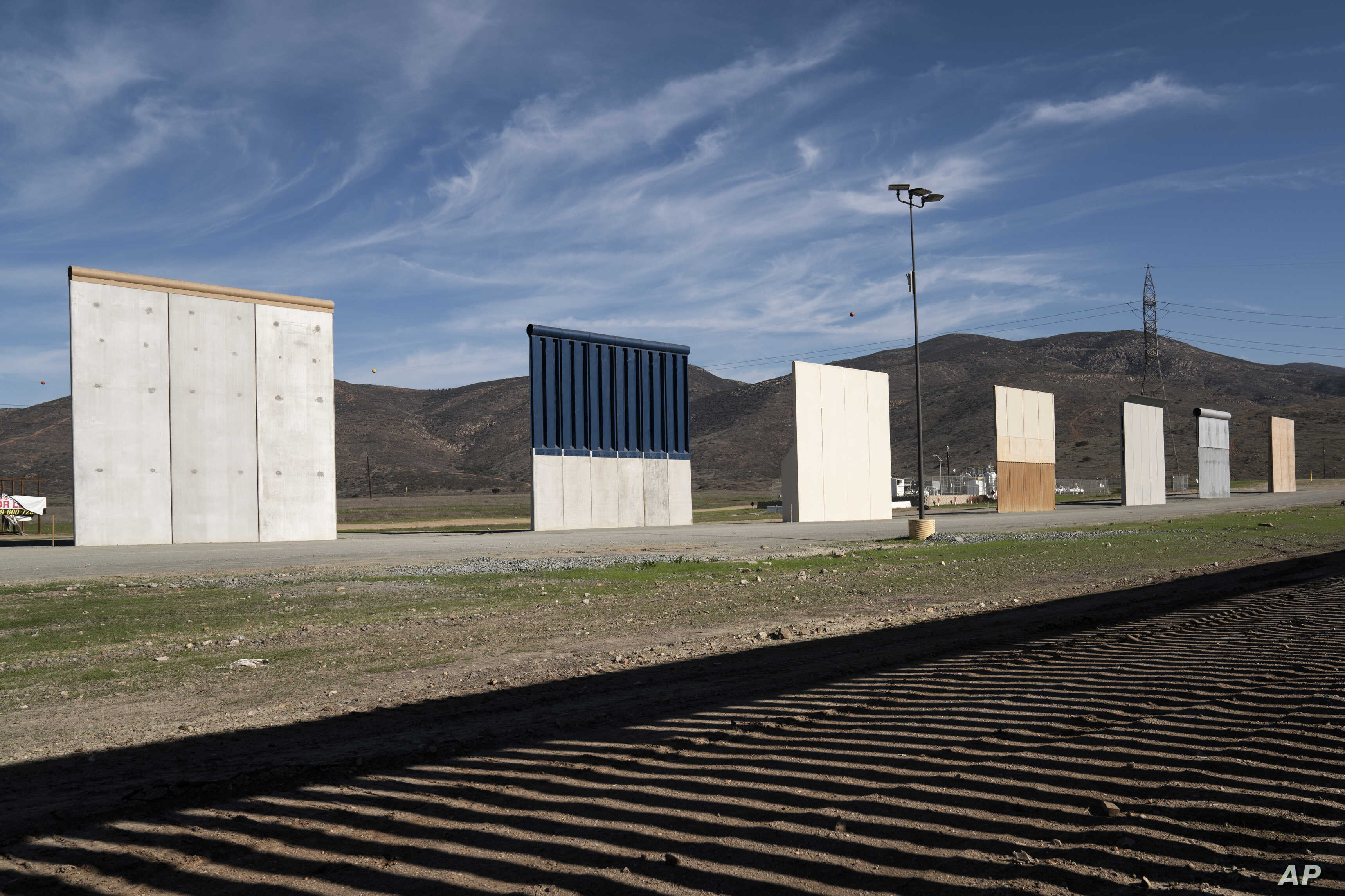 Border wall prototypes stand in San Diego near the Mexico U.S. border, seen from Tijuana, Dec. 22, 2018. The U.S. federal government remains partially closed in a protracted standoff over President Donald Trump's demand for money to build a border wa...