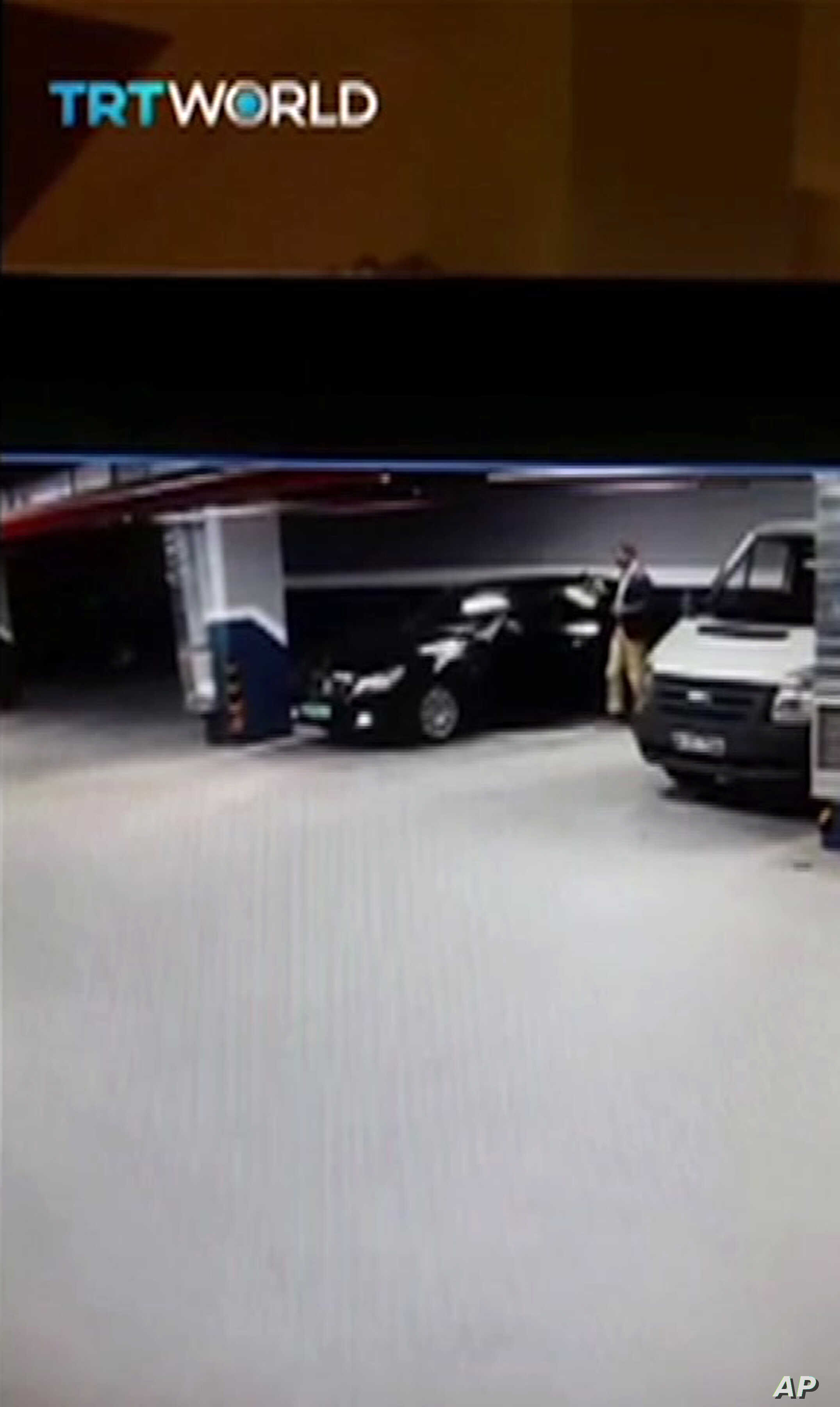 In this CCTV video made available from Turkish TRT TV, Oct. 22, 2018, showing a man getting out of a vehicle seemingly with Saudi consulate plates, at an underground car park in Istanbul.