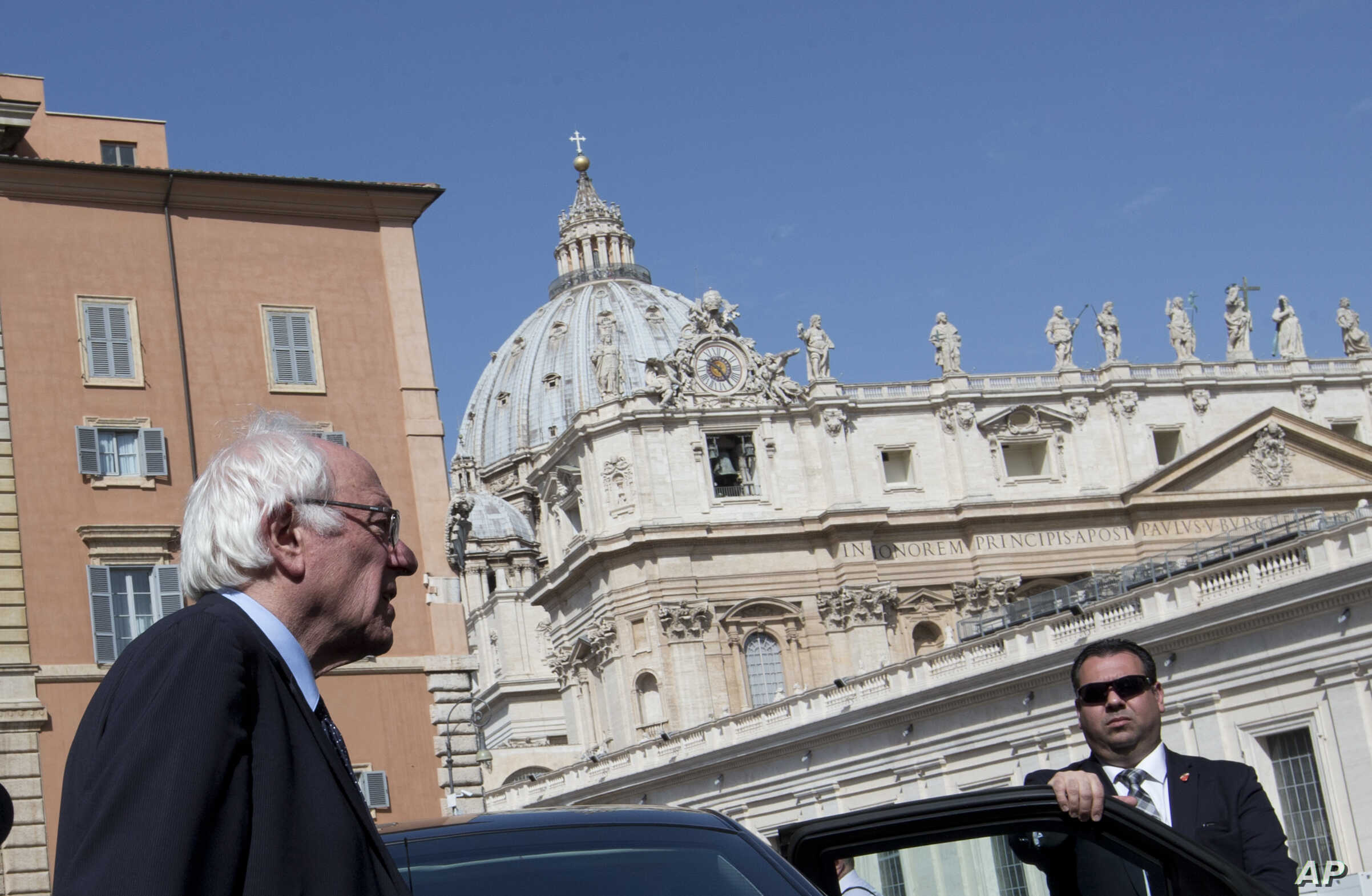 US presidential candidate Bernie Sanders, backdropped by the dome of St. Peter's Basilica, leaves after an interview with the Associated Press, at the Vatican, April 16, 2016.