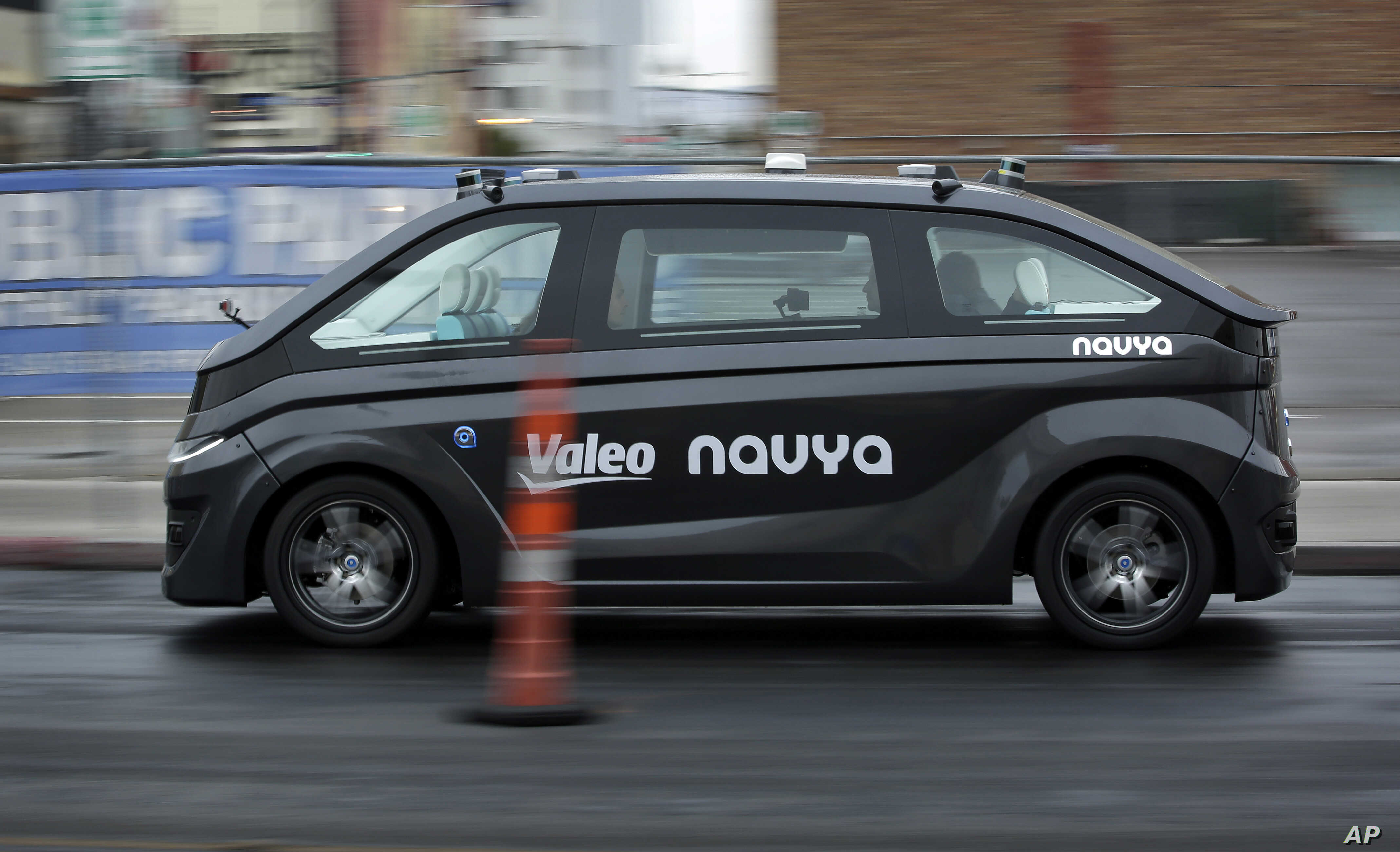 A Navya Autonom Cab, a self-driving vehicle, drives down a street during a demonstration at CES International, in Las Vegas, Nevada, Jan. 8, 2018.