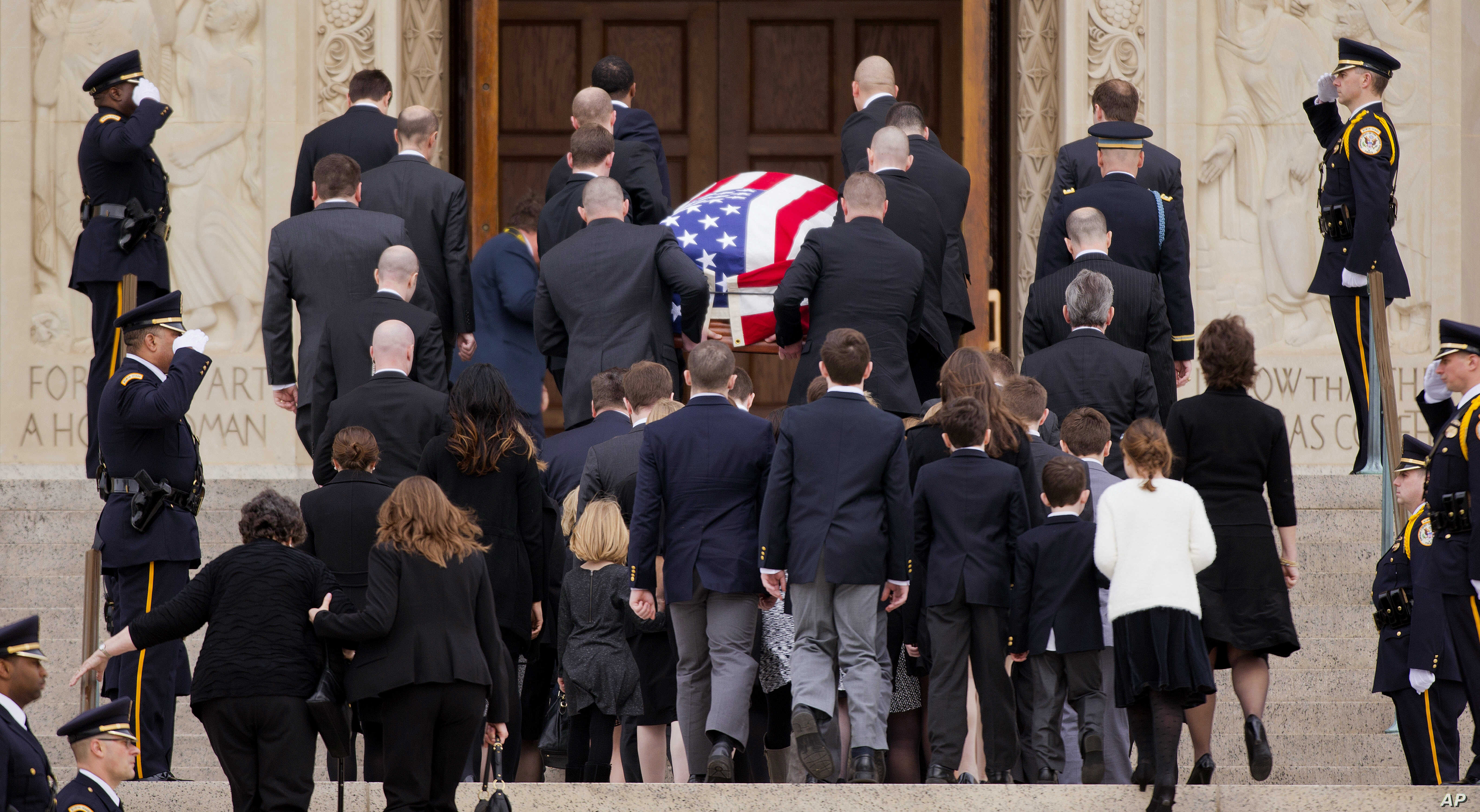 Family members follow behind the casket of the late Supreme Court Associate Justice Antonin Scalia as they arrive for a funeral Mass at the Basilica of the National Shrine of the Immaculate Conception in Washington, Feb. 20, 2016.