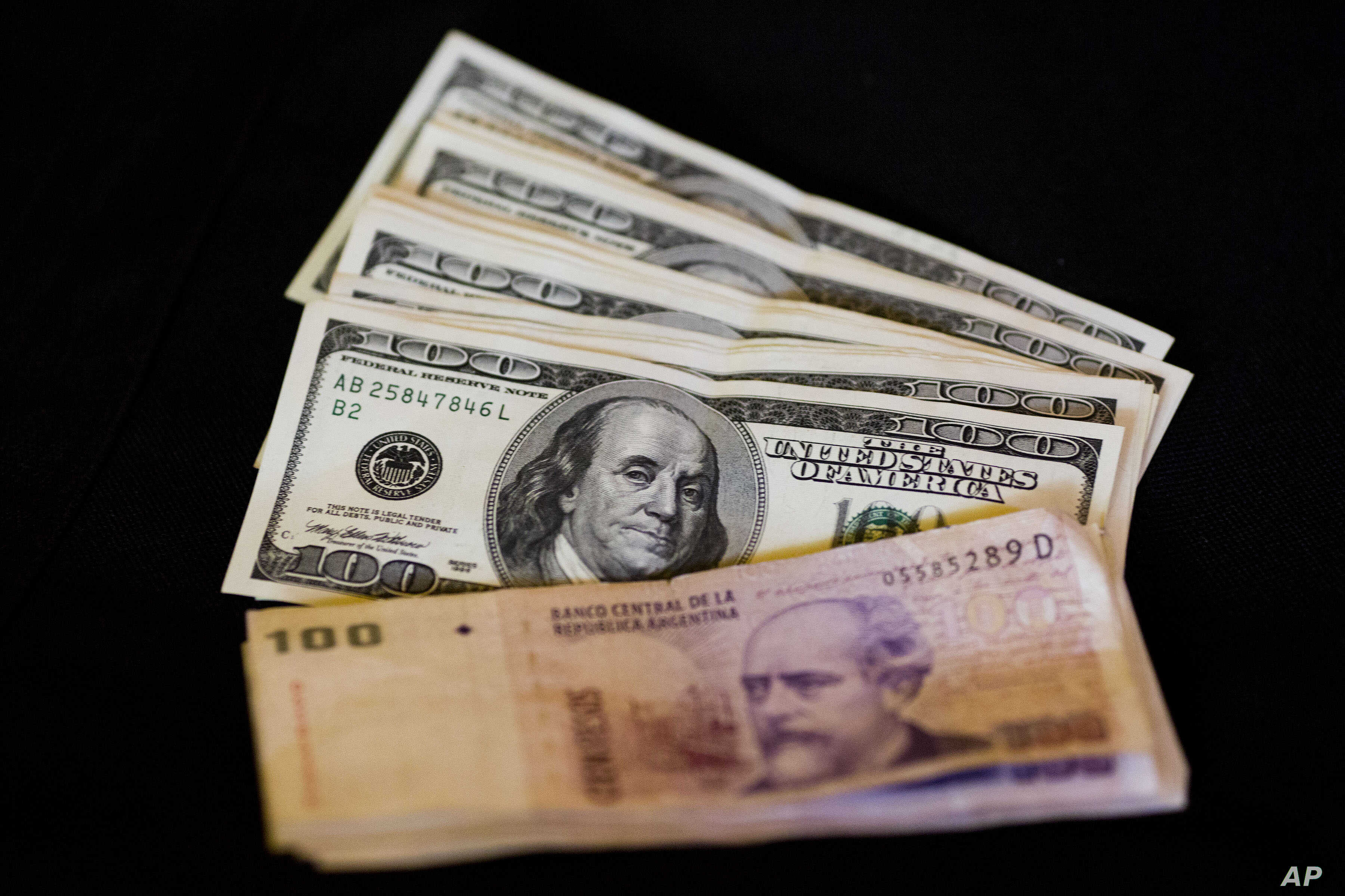 Argentine Peso Ends Higher After Central Bank Sells Dollars