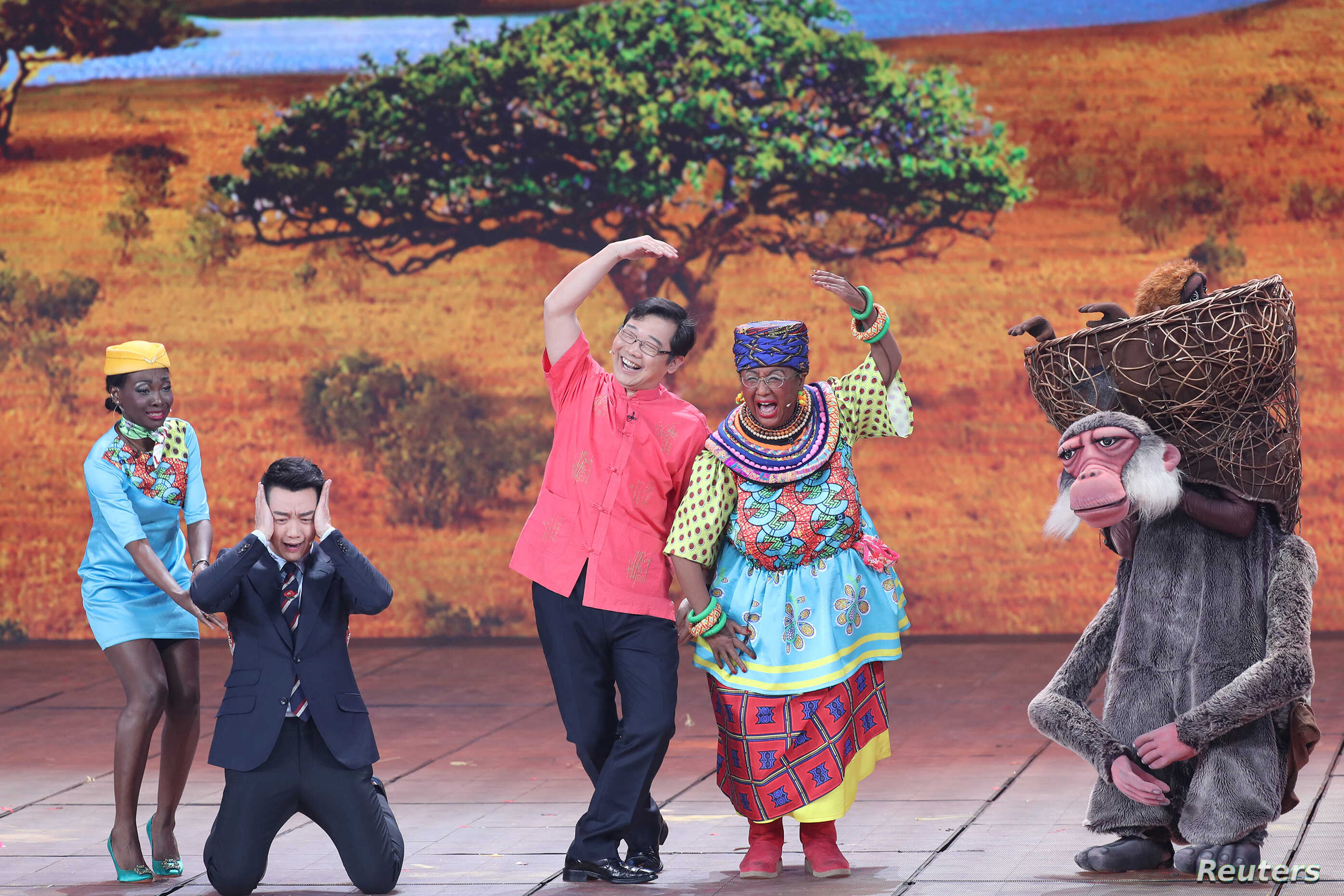 Chinese actor Lou Naiming, 2nd right, performs a skit on a Lunar New Year gala in Beijing, China, Feb. 15, 2018.