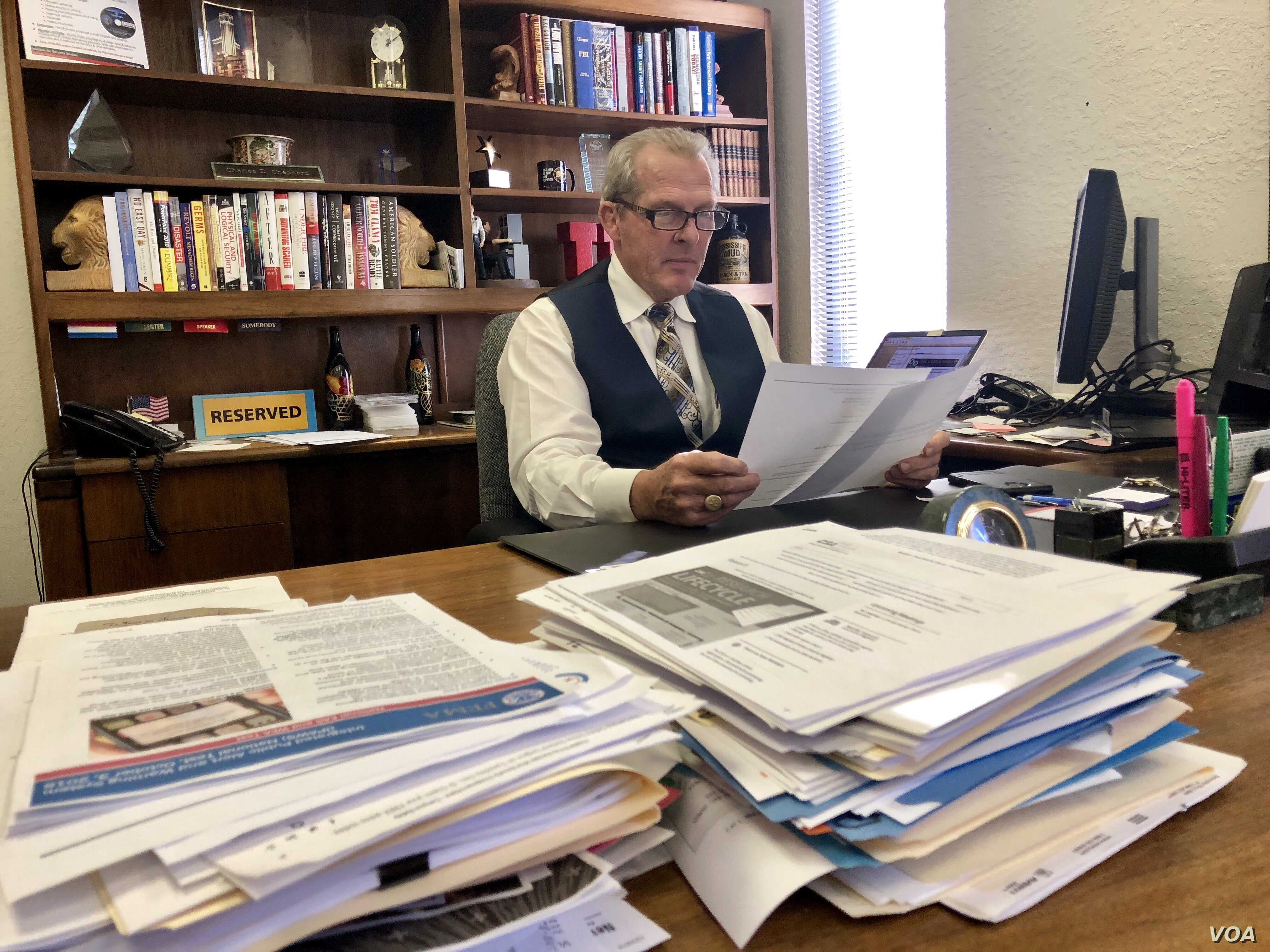 C. David Shepherd reviews documents in his Las Vegas office. Shepherd owns the Readiness Resource Group and was head of security of the Venetian Hotel and Casino for nearly eight years.