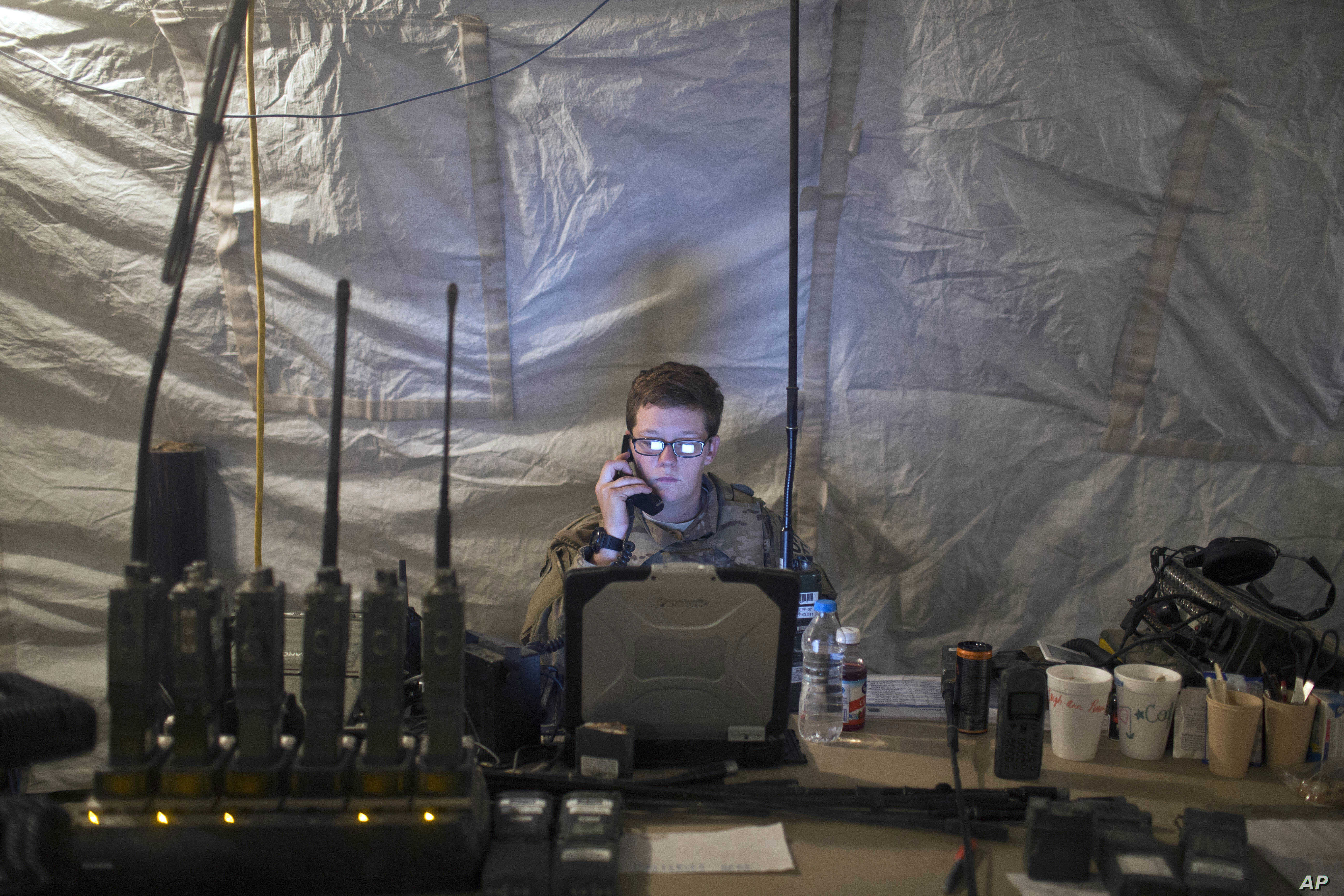 A U.S. Air Force service member uses radio communication at the command and control center inside a coalition air base in Qayara, some 50 kilometers south of Mosul, Iraq, Oct. 28, 2016. The U.S. military says Iraqi forces have retaken 40 villages fro...