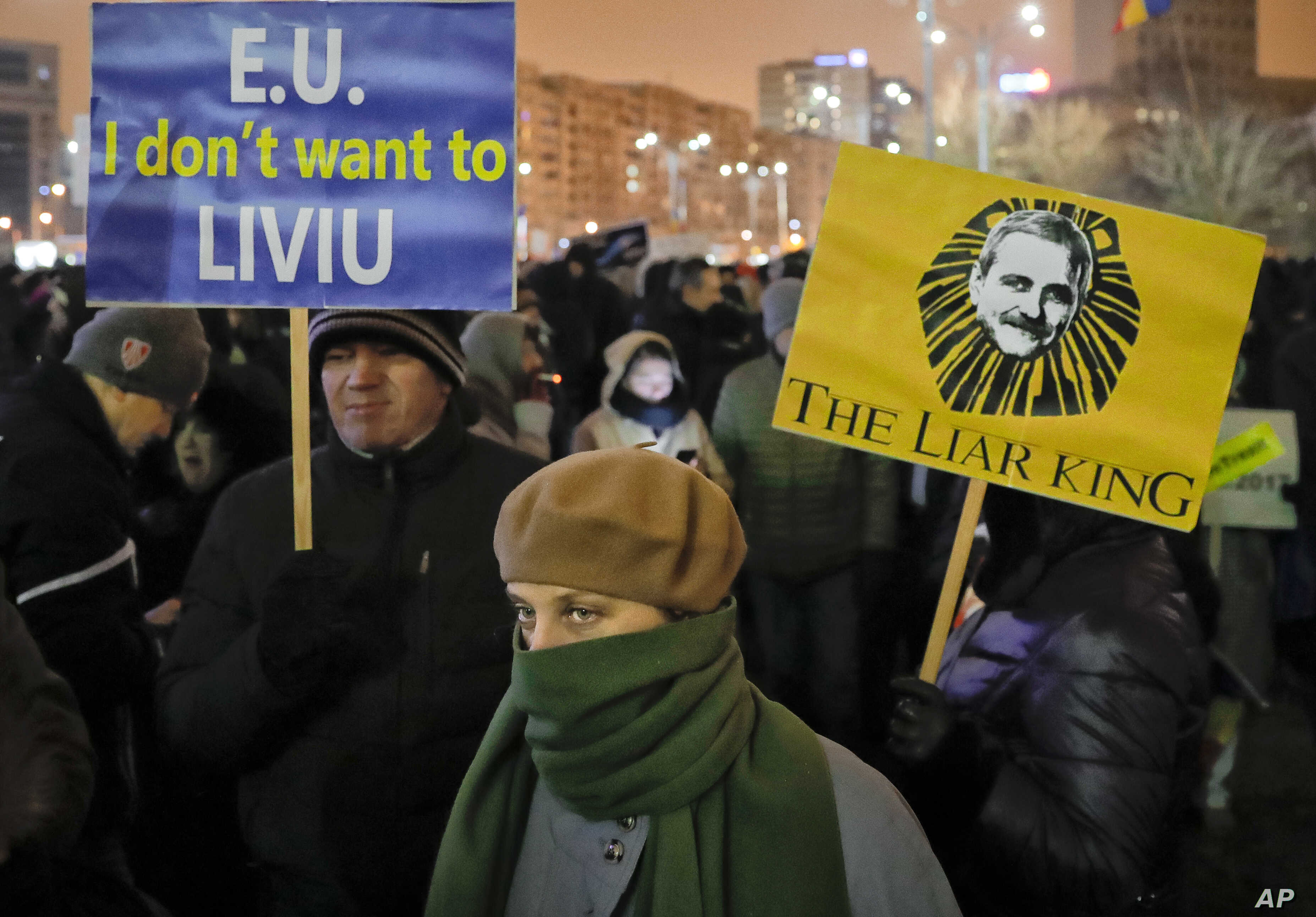 Demonstrators hold banners depicting the head of the ruling Social Democrat party Liviu Dragnea during an anti-government protest in Bucharest, Romania, Feb. 11, 2017.