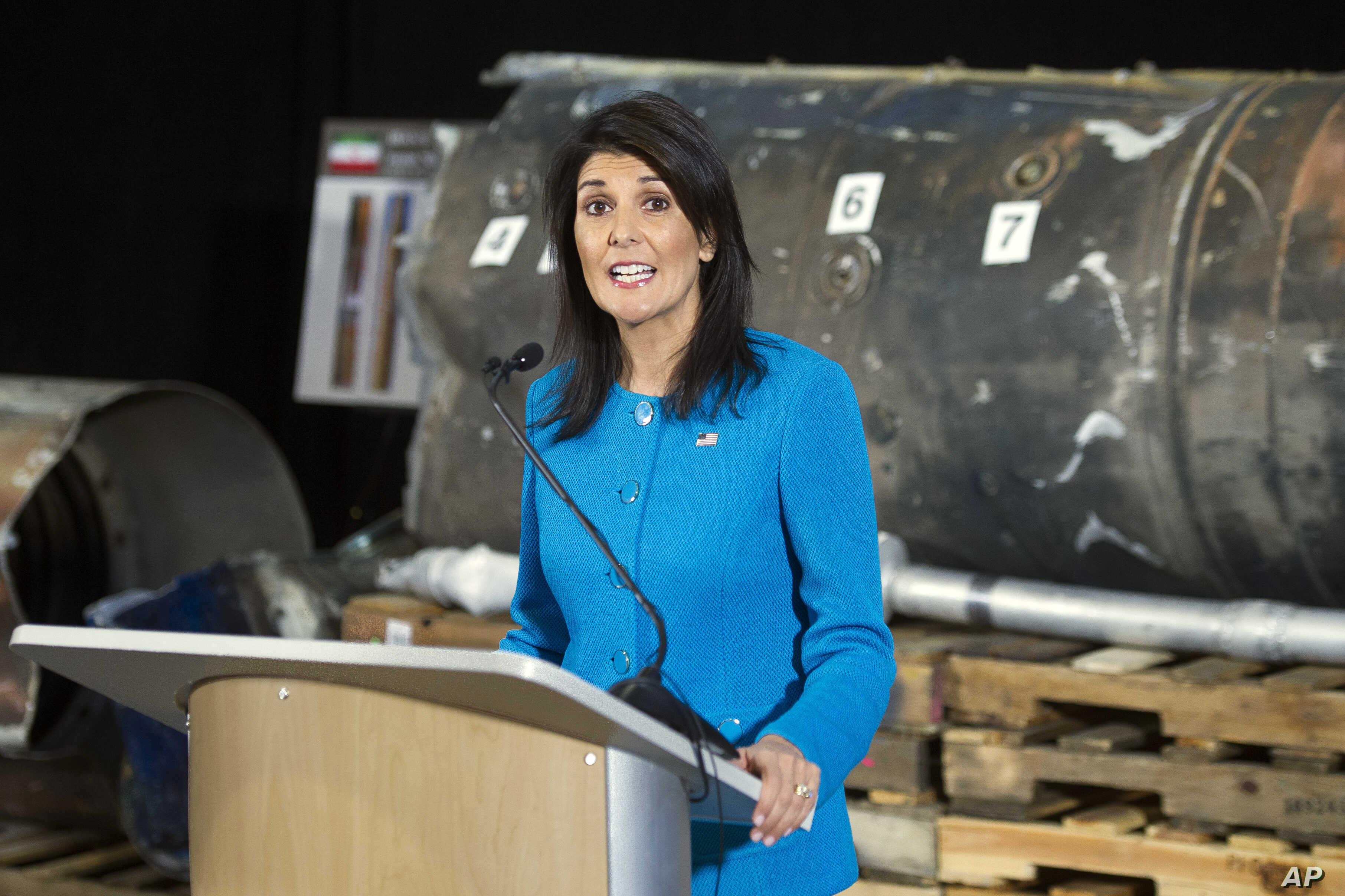 "U.S. Ambassador to the U.N. Nikki Haley speaks in front of recovered segments of an Iranian rocket during a press briefing at Joint Base Anacostia-Bolling, Dec. 14, 2017, in Washington. Haley says ""undeniable"" evidence proves Iran is violating inter..."