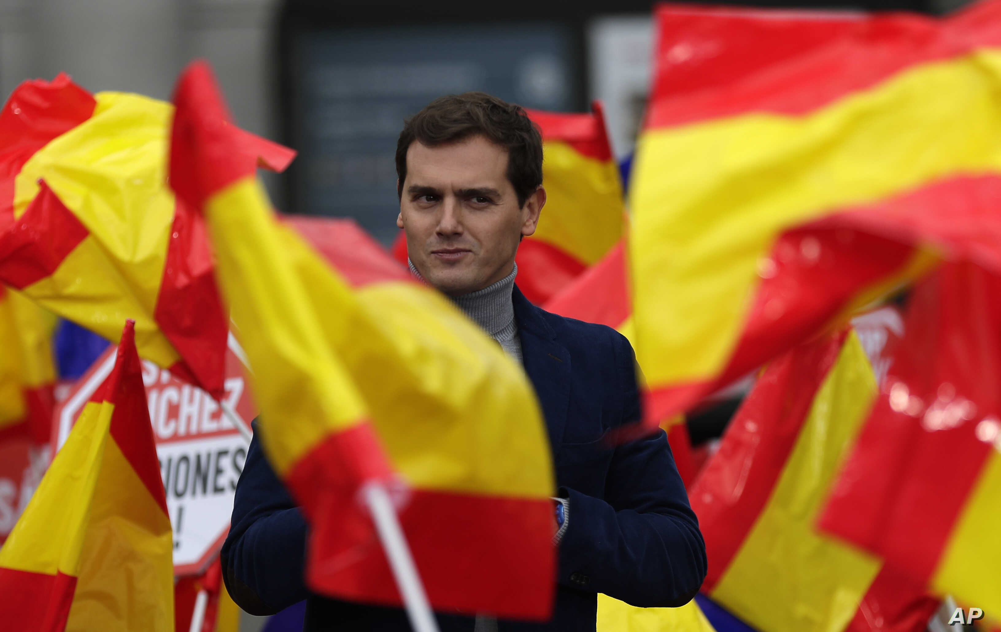 FILE - Leader of the centre right Ciudadanos party, Albert Rivera, addresses the crowd during political meeting demonstrating against Spain's Prime Minister Pedro Sanchez in Madrid, Spain, Saturday, Nov. 24, 2018.