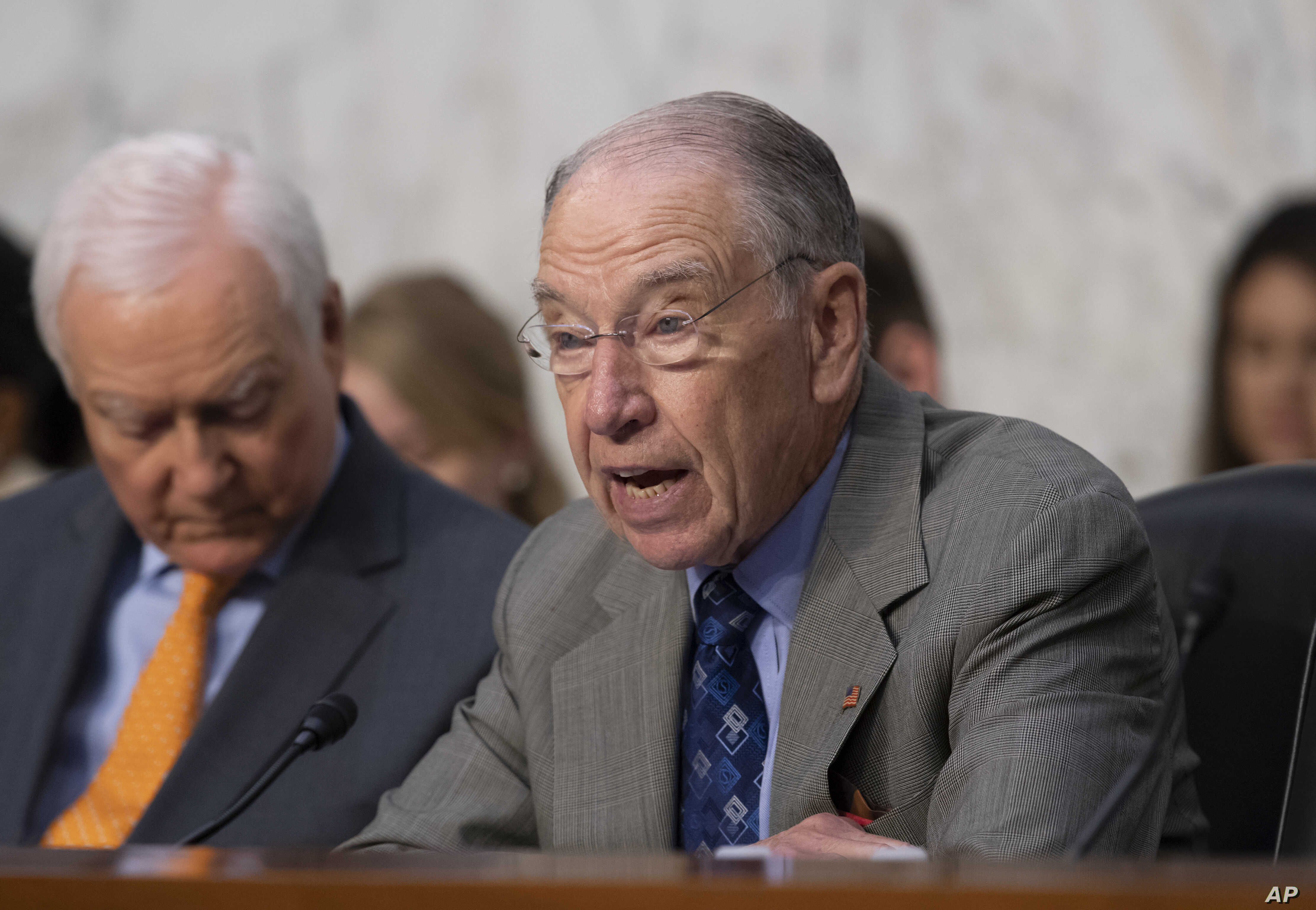 Senate Judiciary Committee Chairman Chuck Grassley, R-Iowa, joined by Sen. Orrin Hatch, R-Utah, left, opens a hearing on the Trump administration's policies on immigration enforcement and family reunification efforts, on Capitol Hill in Washington, J...