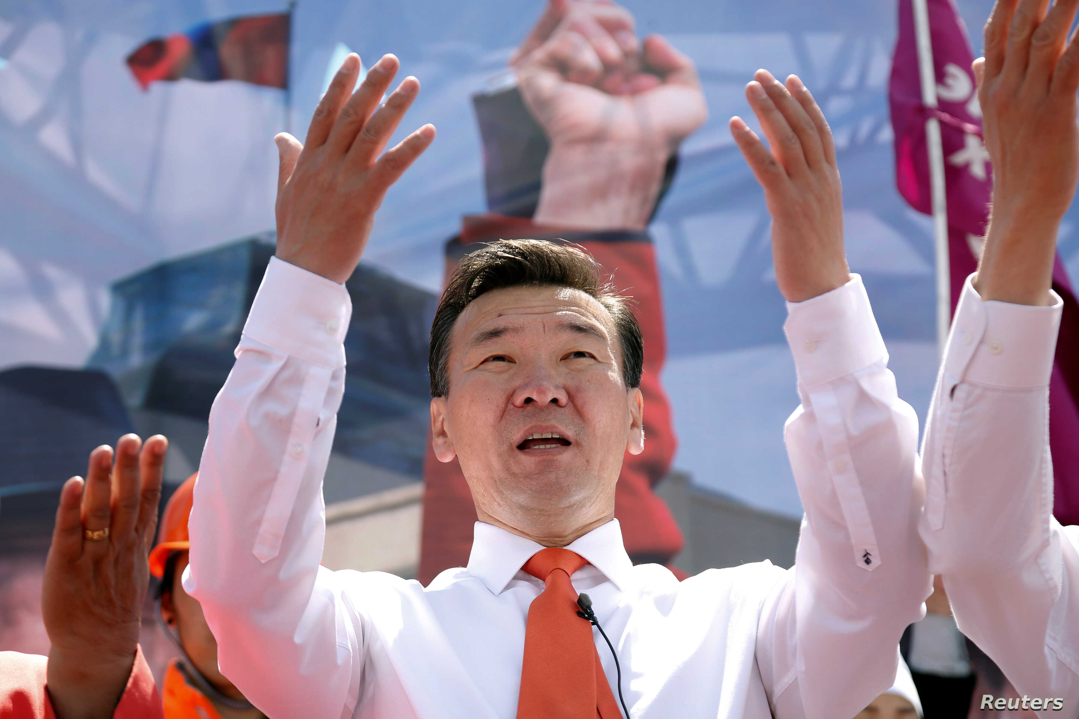 Sainkhuu Ganbaatar of the Mongolian People's Revolutionary Party (MPRP) waves to supporters as he begins campaigns in the Mongolian presidential elections in Ulaanbaatar, Mongolia, June 6, 2017.