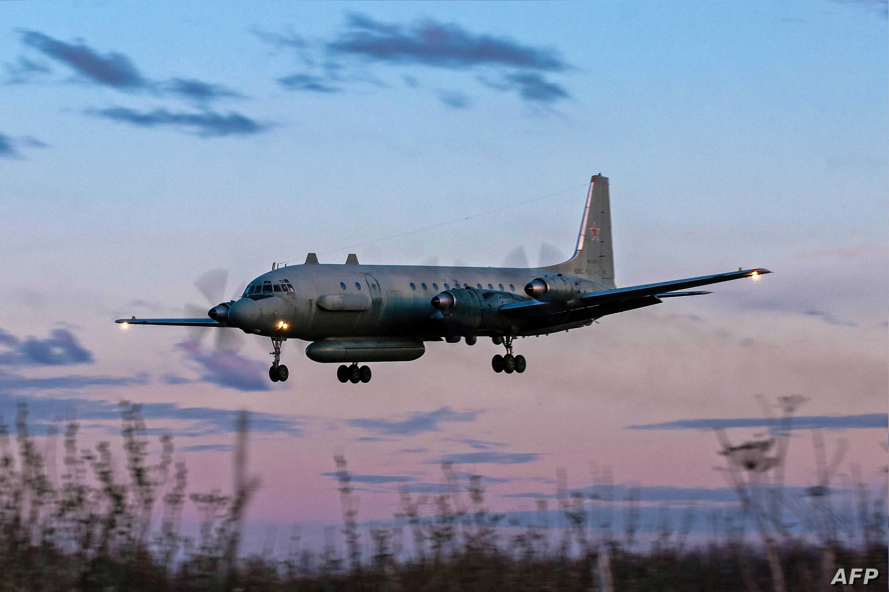 A photo taken on July 23, 2006 shows an Russian IL-20M (Ilyushin 20m) plane landing at an unknown location. Russia blamed Israel on Sept. 18, 2018 for the loss of a military IL-20M jet to Syrian fire, which killed all 15 servicemen on board, and thre...