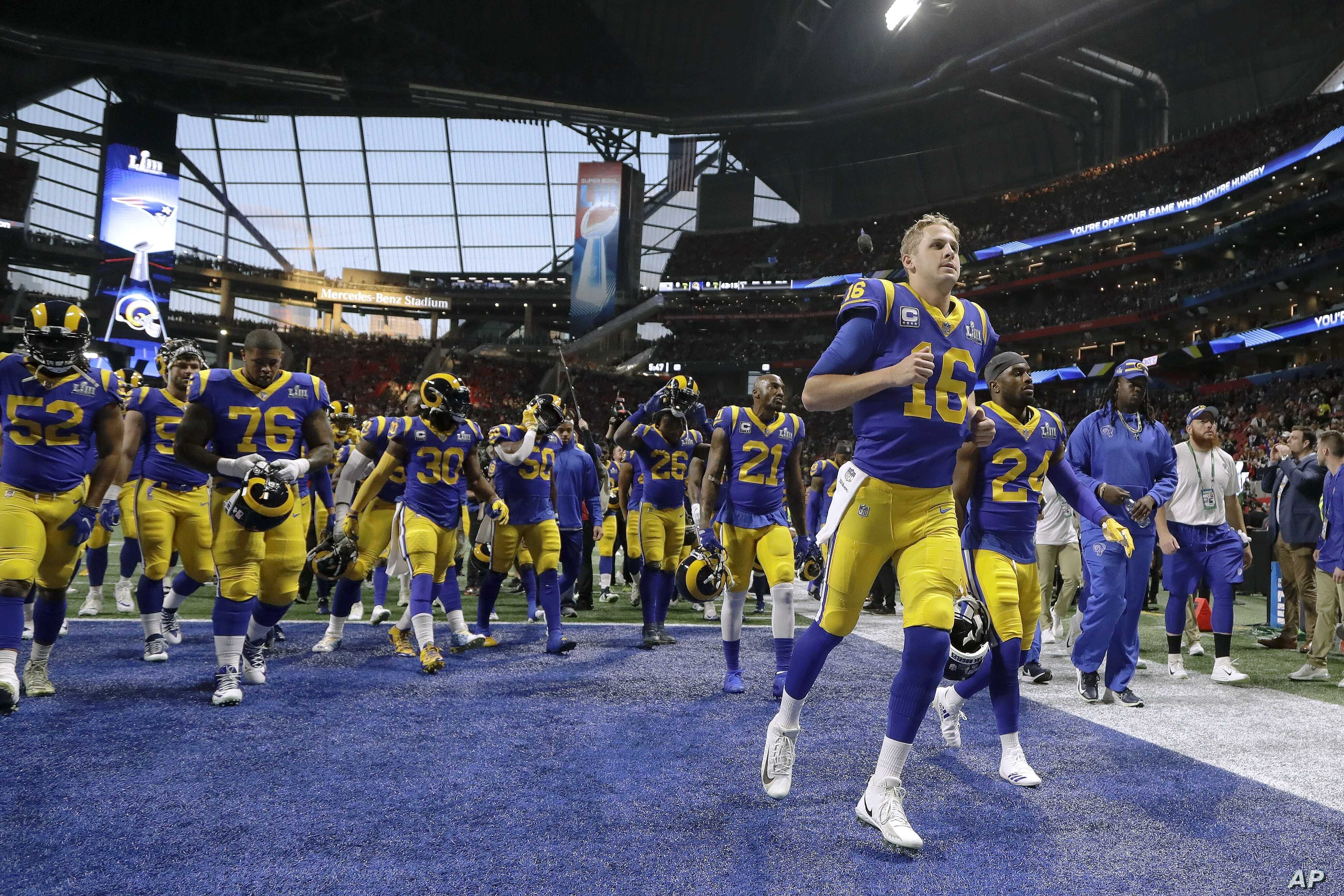 Los Angeles Rams players are seen before the NFL Super Bowl football game between the Rams and the New England Patriots, Feb. 3, 2019, in Atlanta.