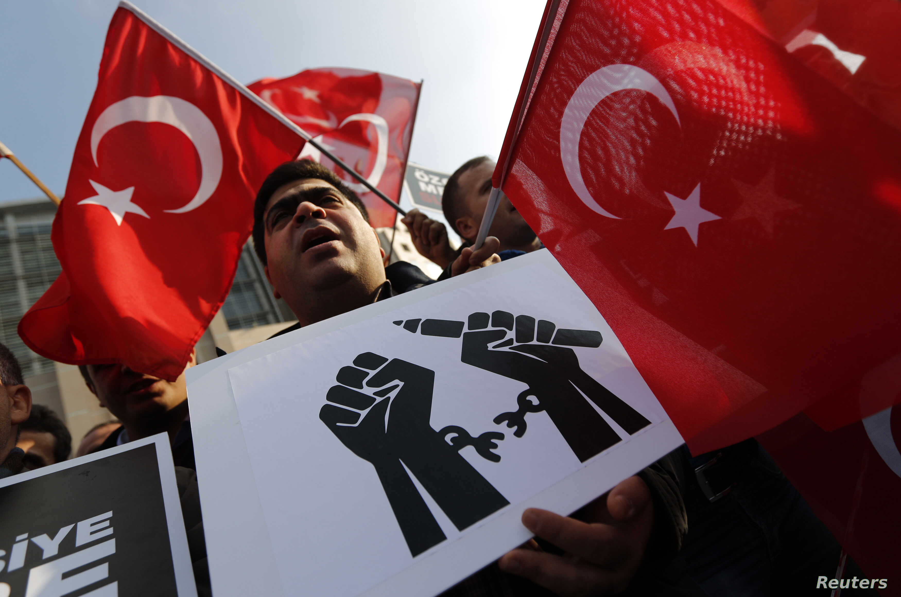 Supporters of the Gulen movement wave Turkish flags as they gather outside the Justice Palace in Istanbul, Dec. 19, 2014.