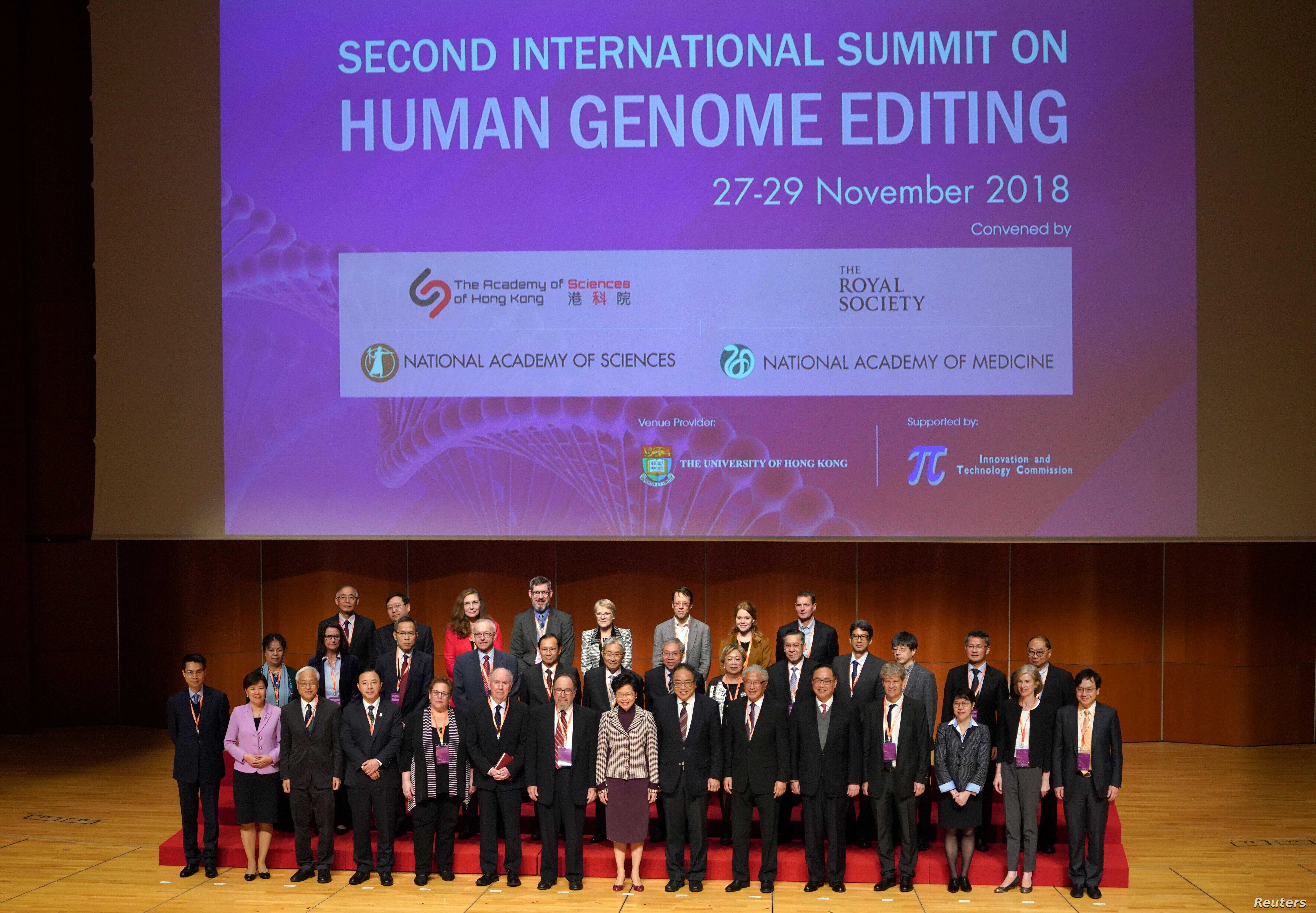 Hong Kong Executive Carrie Lam (C) and guests pose for a group photo during the International Summit on Human Genome Editing in Hong Kong, Nov. 27, 2018. (Zhang Wei/CNS via Reuters)