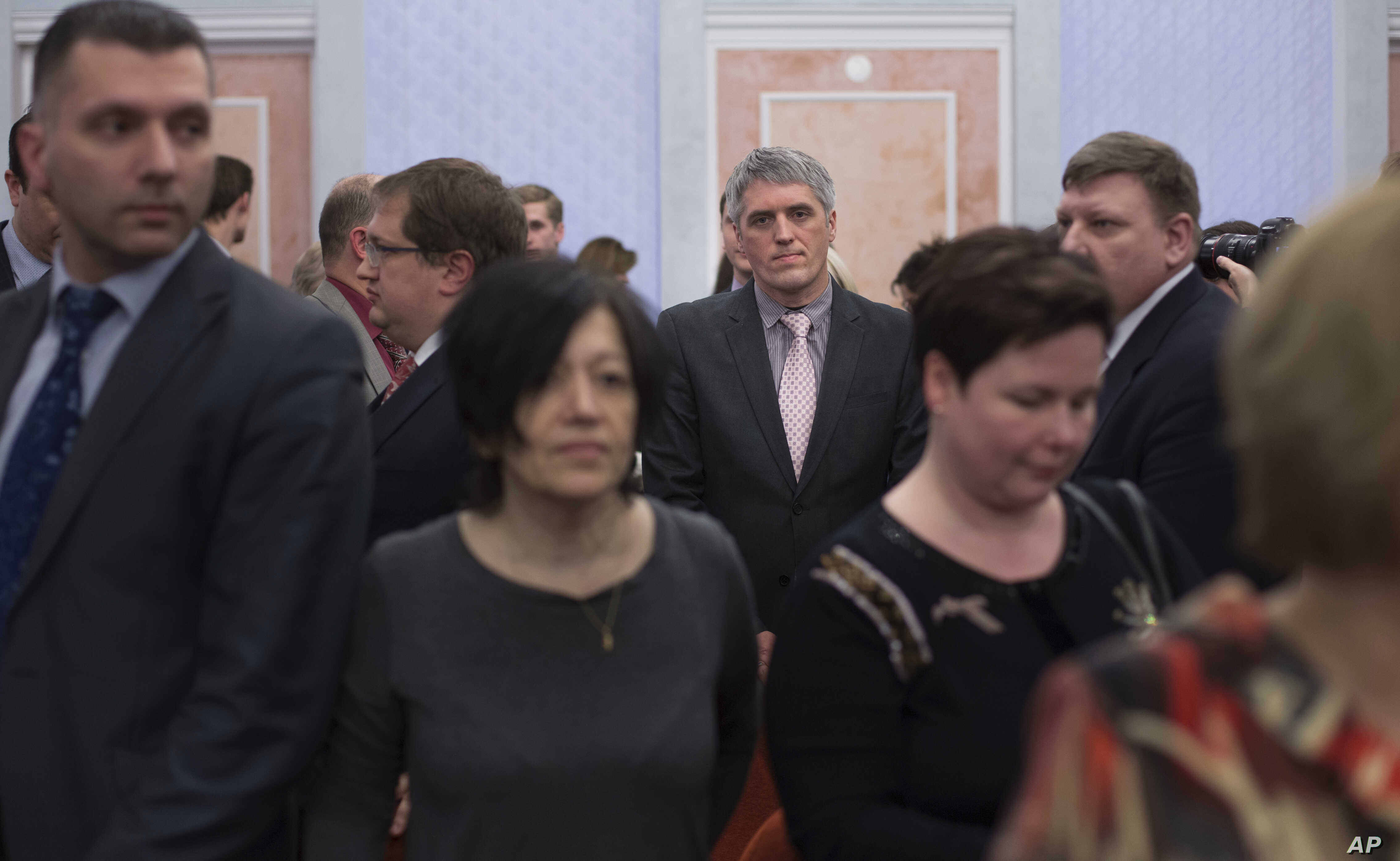 Members of Jehovah's Witnesses react in a court room after a judge's decision in Moscow, April 20, 2017. Russia's Supreme Court has banned the Jehovah's Witnesses from operating in the country.