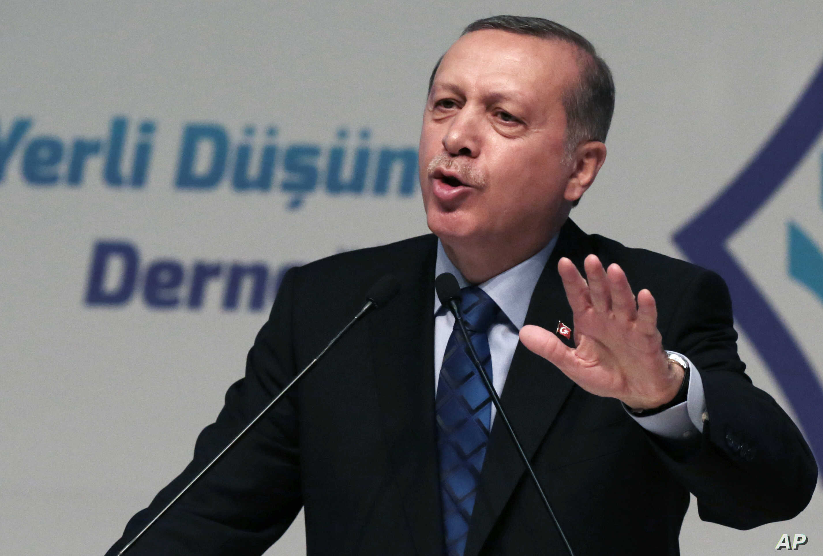 "Turkey's President Recep Tayyip Erdogan addresses his supporters in Ankara, Turkey, Thursday, May 12, 2016. Erdogan says his country is gearing up to ""clear"" the Syrian side of its frontier in response to cross-border fire from the Islamic State grou..."